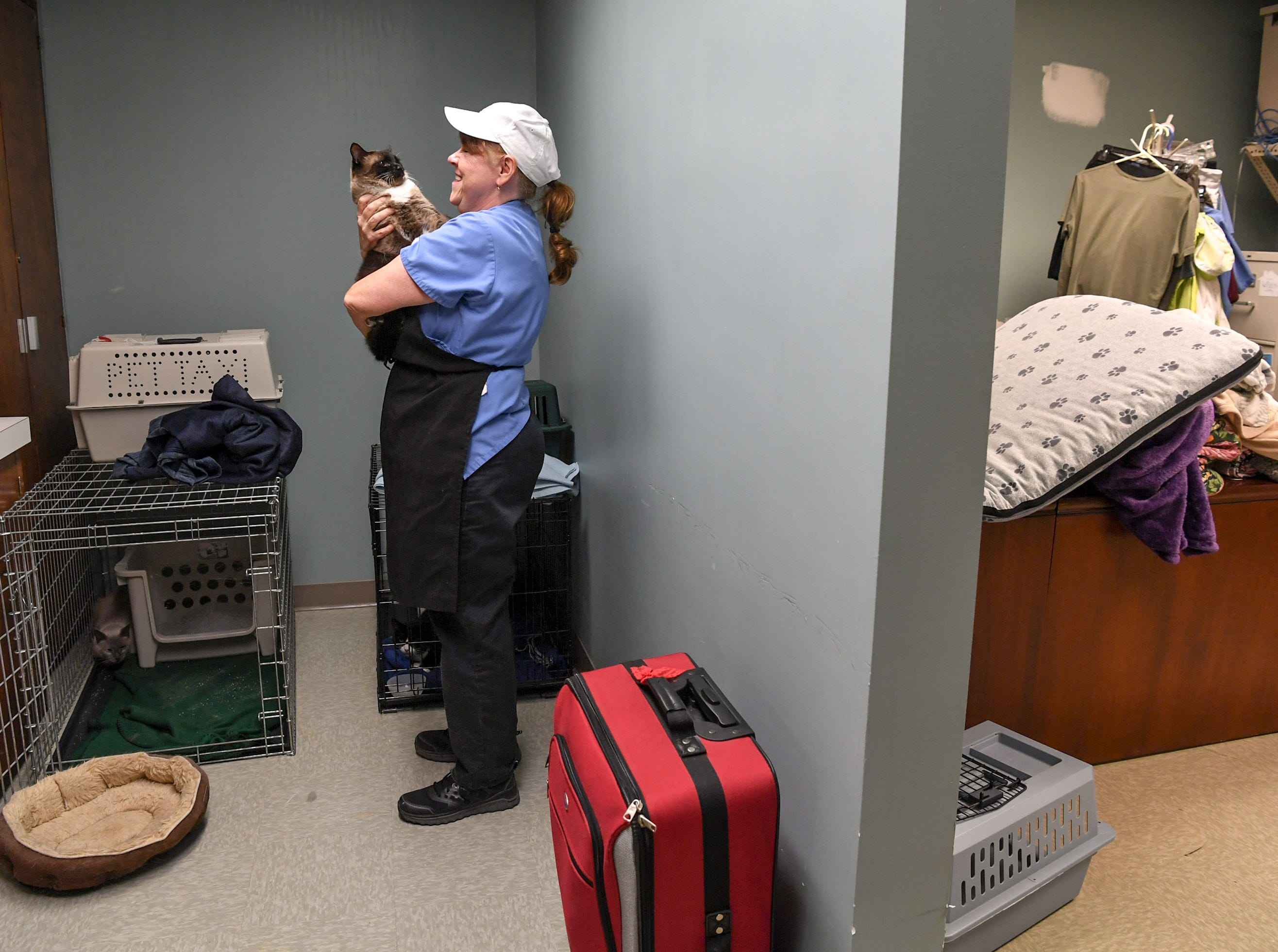 Andrea Zowalki holds her cat Chu Chu in a room she could sleep and keep her cat in during Hurricane Florence, at the Davis Community nursing home and assisted living facility in Wilmington, North Carolina on Thursday, September 13, 2018. (Ken Ruinard / Greenville News / Gannett USA Today Network / 2018 )