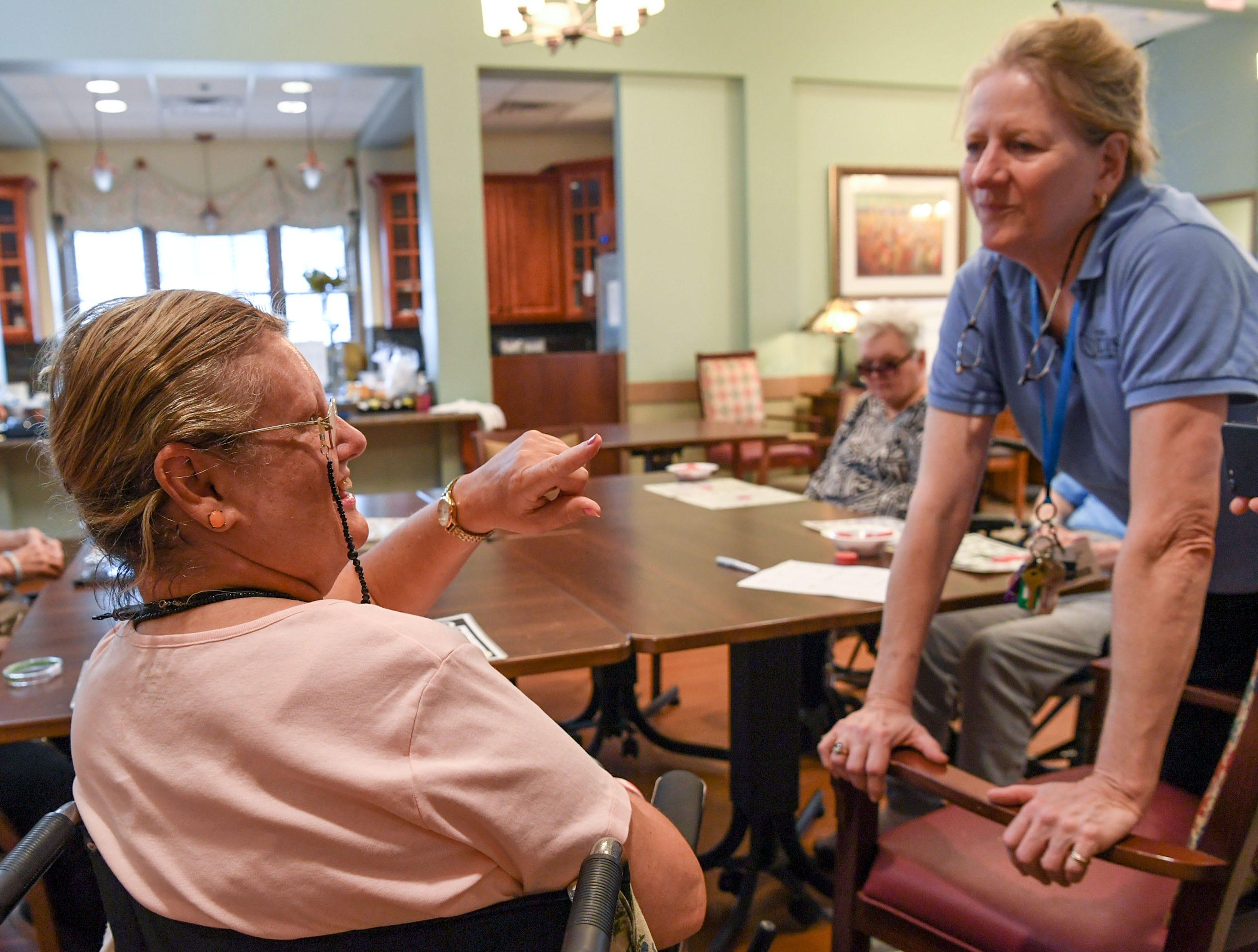 Laura Still, left, talks with Julie Rehder, spokeswoman at the Davis Community nursing home and assisted living facility in Wilmington, North Carolina on Thursday, September 13, 2018. (Ken Ruinard / Greenville News / Gannett USA Today Network / 2018 )