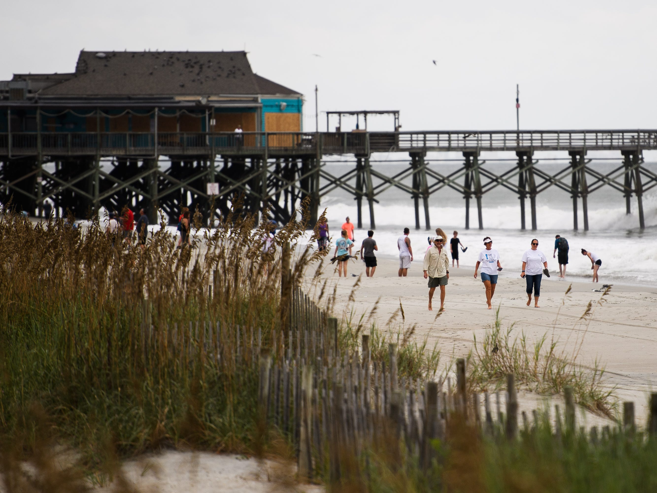 Myrtle Beach residents enjoy the last hours of calm at the Myrtle Beach Boardwalk and Promenade on Thursday, Sept. 13, 2018 before the arrival of Hurricane Florence.