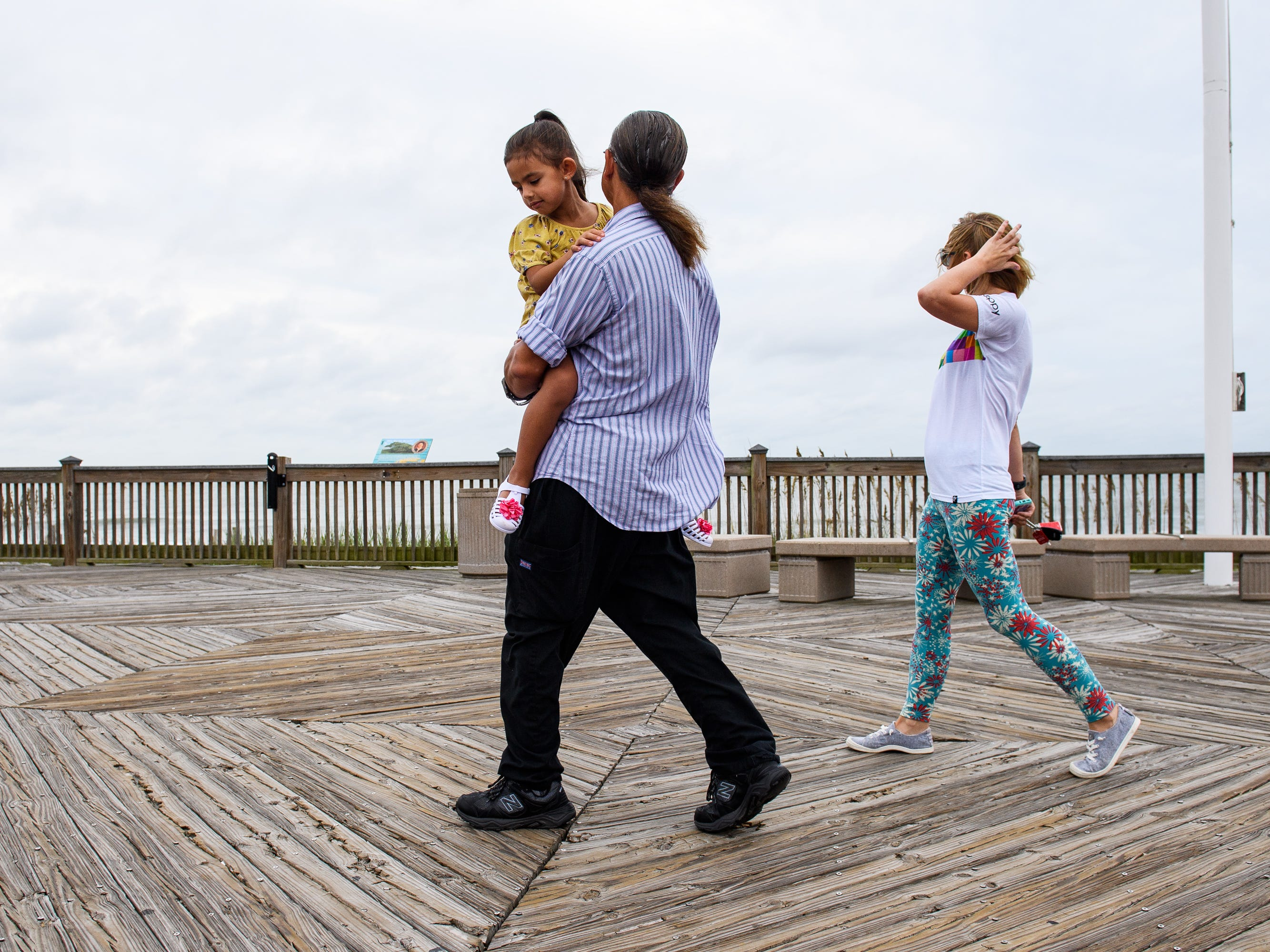 Daniel Dillion walks down the Myrtle Beach Boardwalk and Promenade with his daughter Alexis, 5, and wife Mary on Thursday, Sept. 13, 2018. Dillon said he and his family chose to stay for Hurricane Florence.