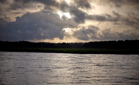 FILE - In this June 10, 2013, file photo, the sun rises over Sapelo Island, Ga., a Gullah-Geechee community. A tight-knit community of slave descendants on the South Carolina coast is used to riding out big storms, from a storm that killed an estimated 2,000 people in 1893 to Tropical Storm Irma last year. (AP Photo/David Goldman, File)