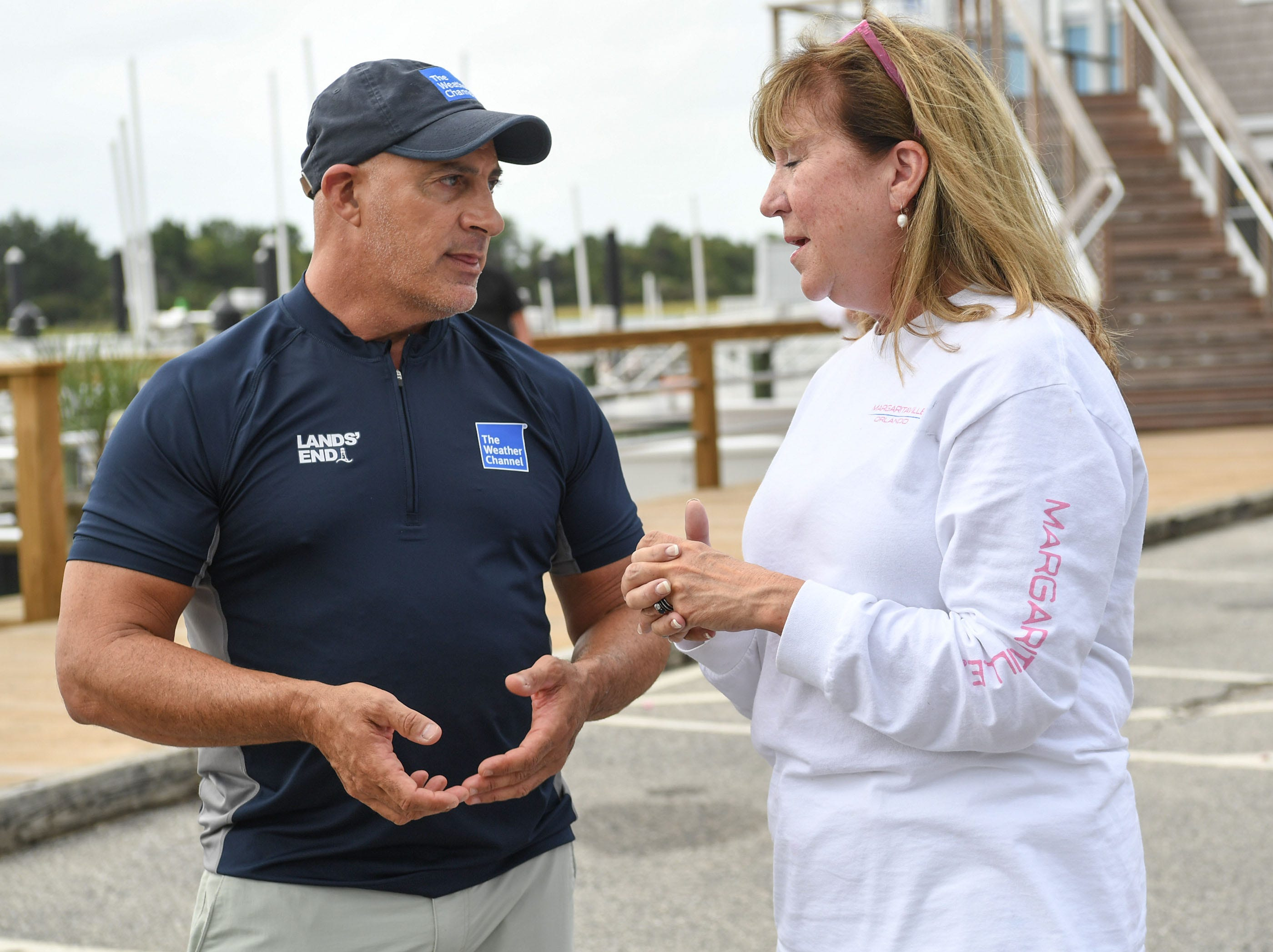 Jim Cantore, left, of The Weather Channel talks with Kathy Gresham of the New Hanover Regional Medical Center at Crocker's Landing in Wilmington, NC before Hurricane Florence in Wilmington, North Carolina on Thursday, September 13, 2018. (Ken Ruinard / Greenville News / Gannett USA Today Network / 2018 )