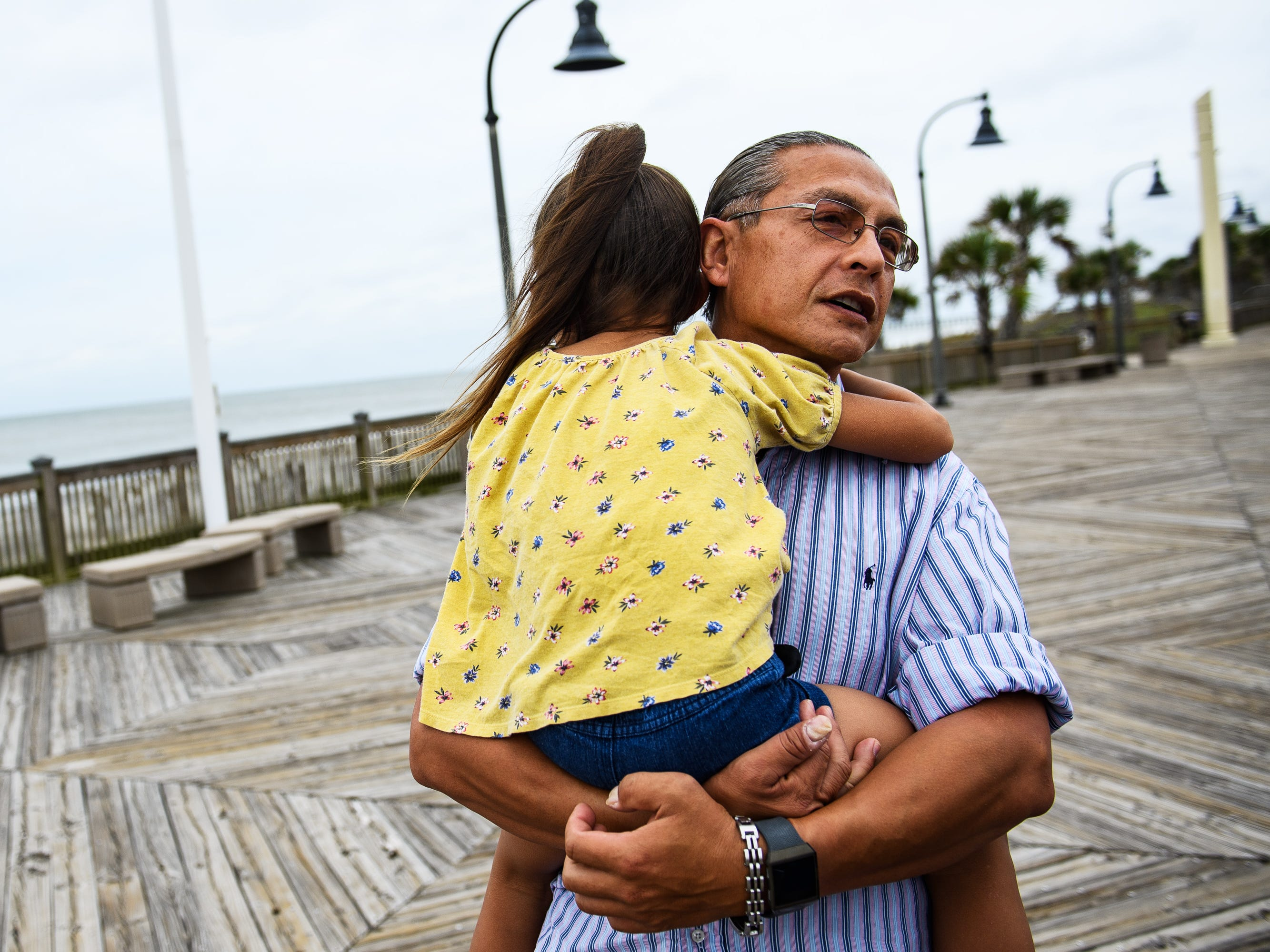 Daniel Dillon holds his daughter Alexis, 5, as he talks about why he chose to stay during Hurricane Florence at the Myrtle Beach Boardwalk and Promenade on Thursday, Sept. 13, 2018.