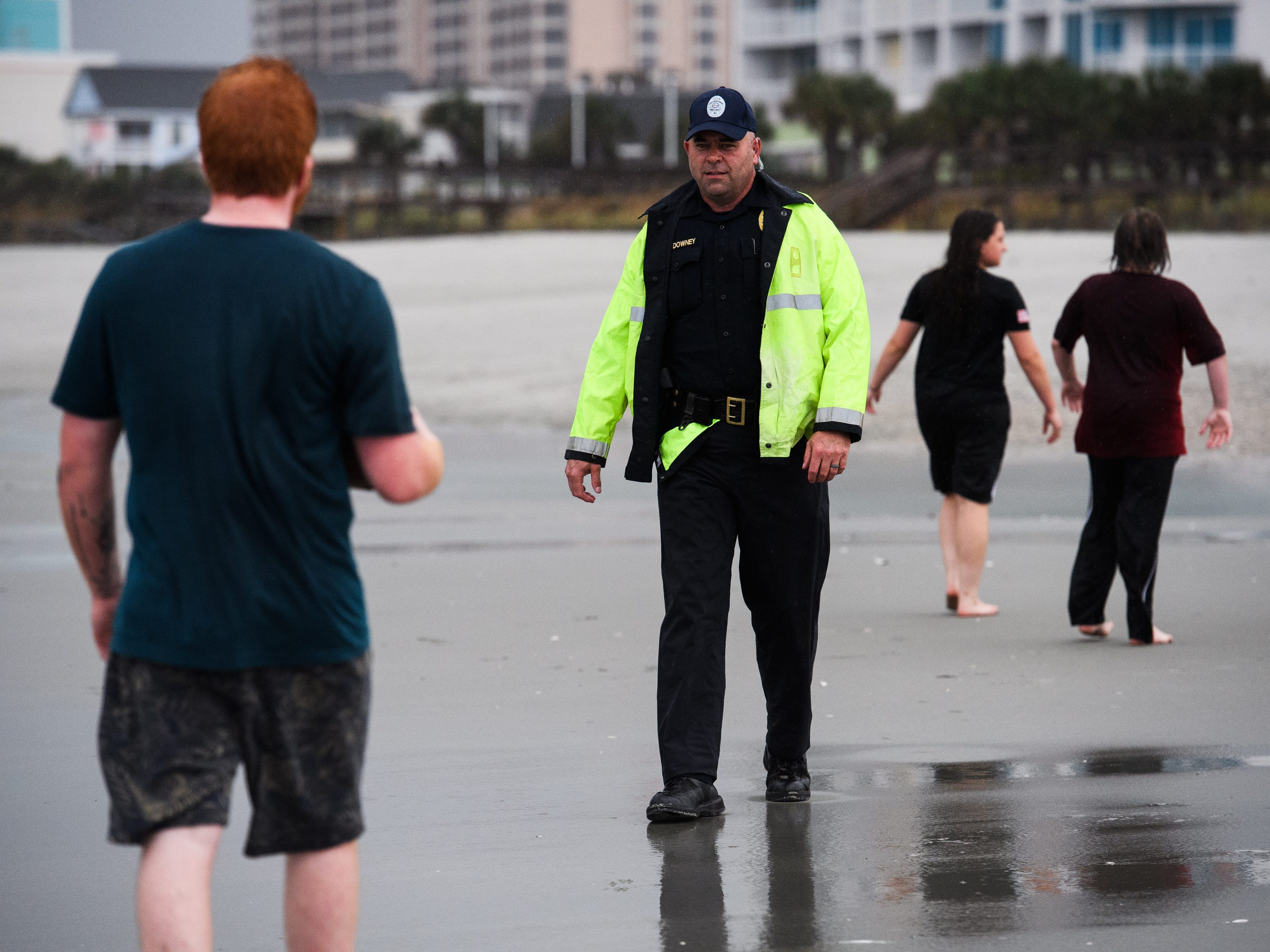 A North Myrtle Beach public safety officer informs beachgoers of the 7 p.m. curfew due to Hurricane Florence on Thursday, Sept. 13, 2018.