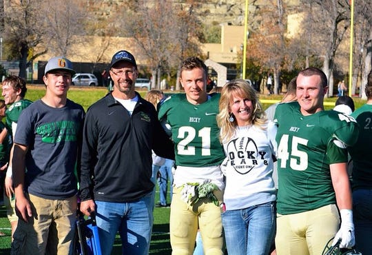 Tucker Meyer (21) and his pal Dayton Cogdill (45) pose at a Rocky game with Ryder Meyer, left, Les Meyer and Jolyn Meyer.