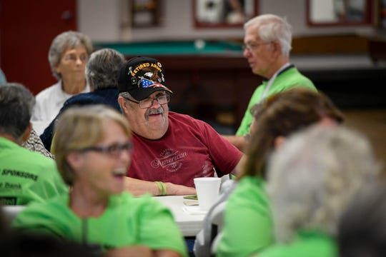 James Culver, center, playing BINGO at the Henderson Senior Games held in the Gathering Place Wednesday, September 12, 2018.