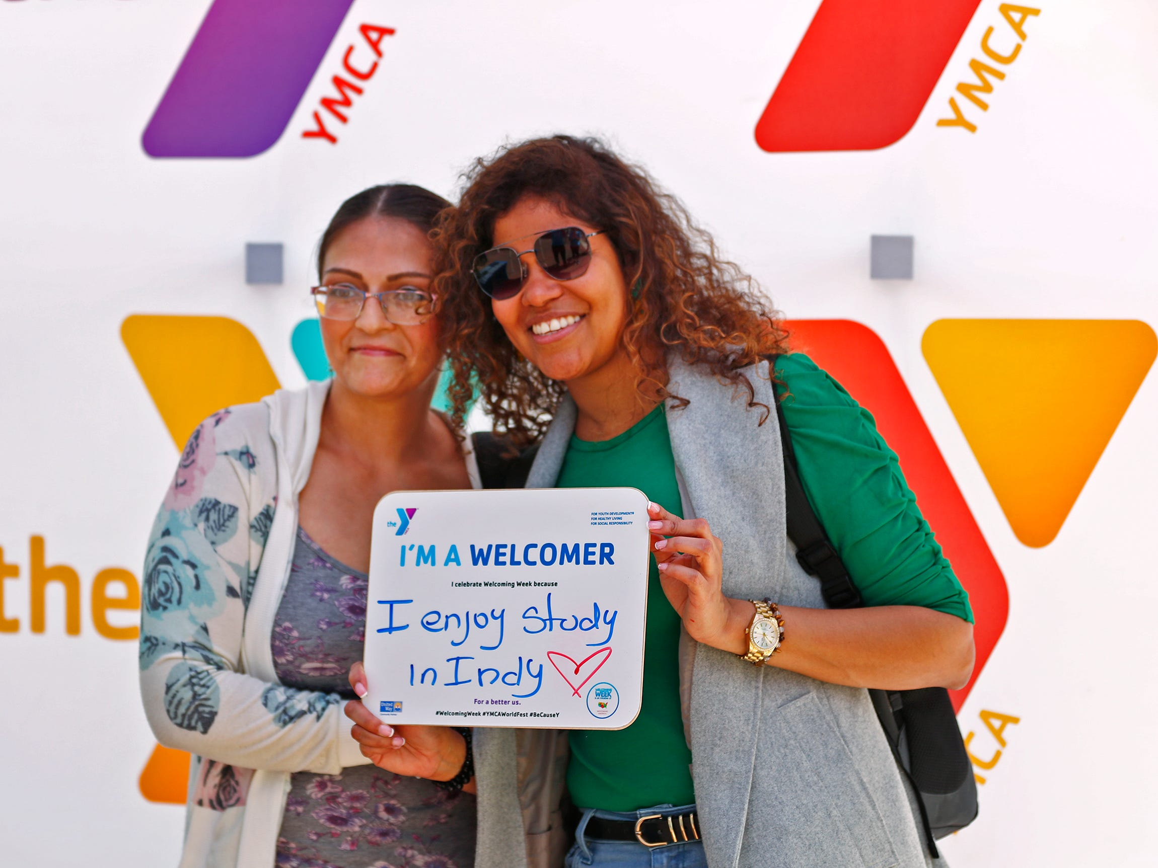 English Language Center (ESL) students Diana Moreno, left, and Margareta Sanchez pose for a photo during the YMCA World Fest, on Monument Circle, Thursday, Sept. 13, 2018. YMCA of Greater Indianapolis hosts the free event that celebrates cultures including international food vendors, music, sports, and performers.