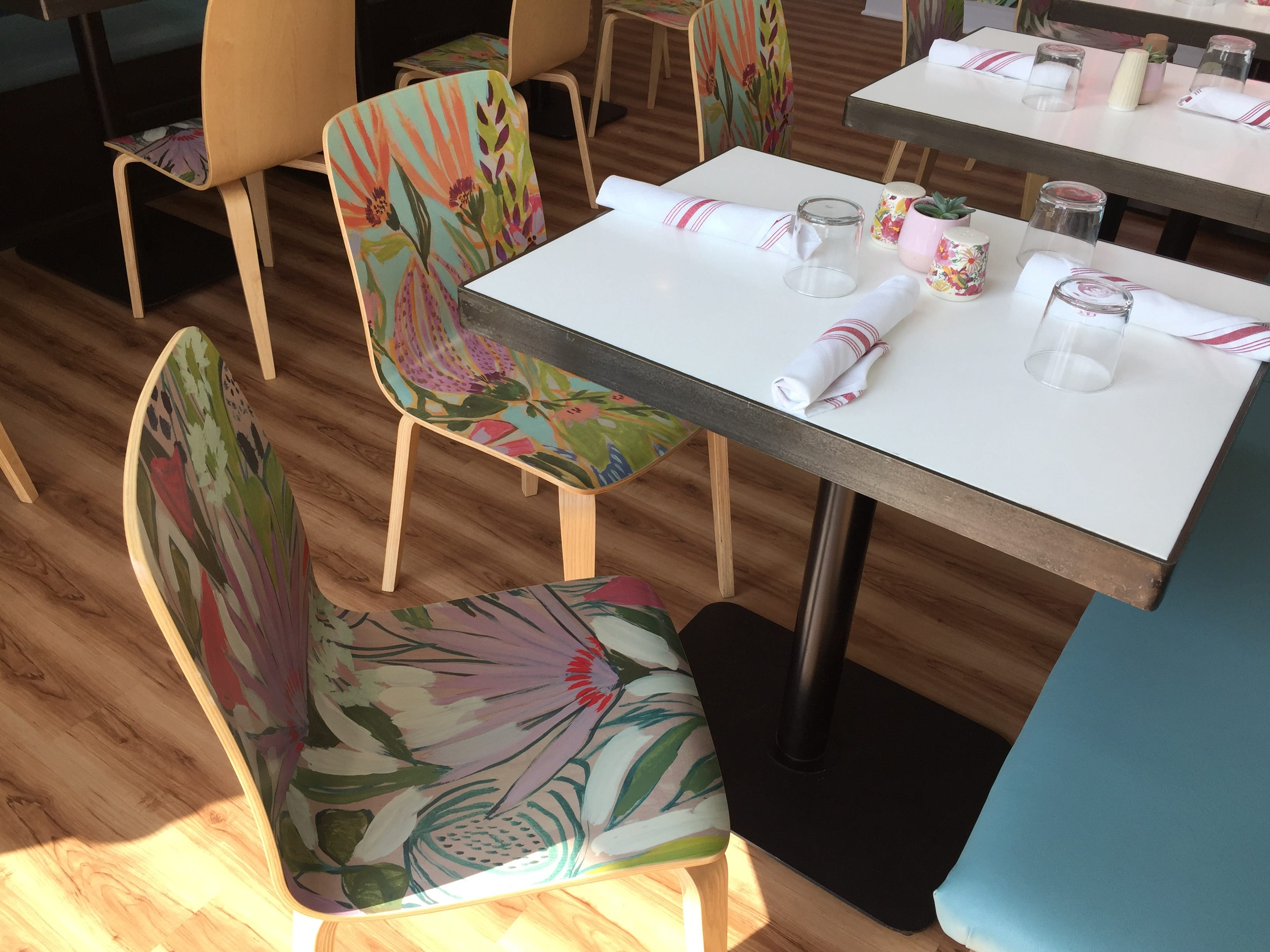 Floral print chairs at Just Pop In! popcorn bar and cafe at 6406 Cornell Ave. in the Broad Ripple  community of Indianapolis.
