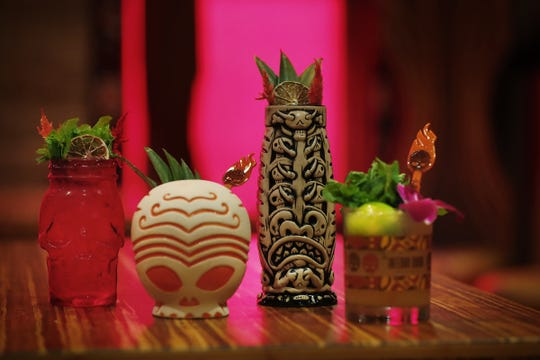 Every cocktail has its own glass at at Inferno Room. Left to right: Skull & Bones, Aloha Felicia, Antakarian Fire Dancer and mai tai. The tiki lounge opened Sept. 11, 2018, in the Fountain Square area of Indianapolis.