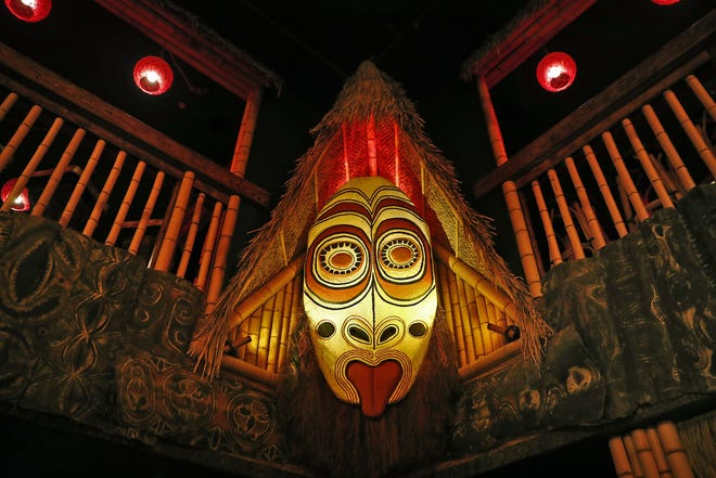Milwaukee artist Dave Hansen of Lake Tiki Woodcrafts hand-carved much of the new art at Inferno Room, including the giant mask overlooking the first floor. Inferno Room tiki bar and restaurant opened Sept. 11, 2018, in the Fountain Square area of Indianapolis.