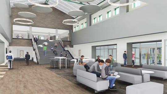 The new media center at Westfield High School will include areas for students to sit on couches and the oversized staircase.