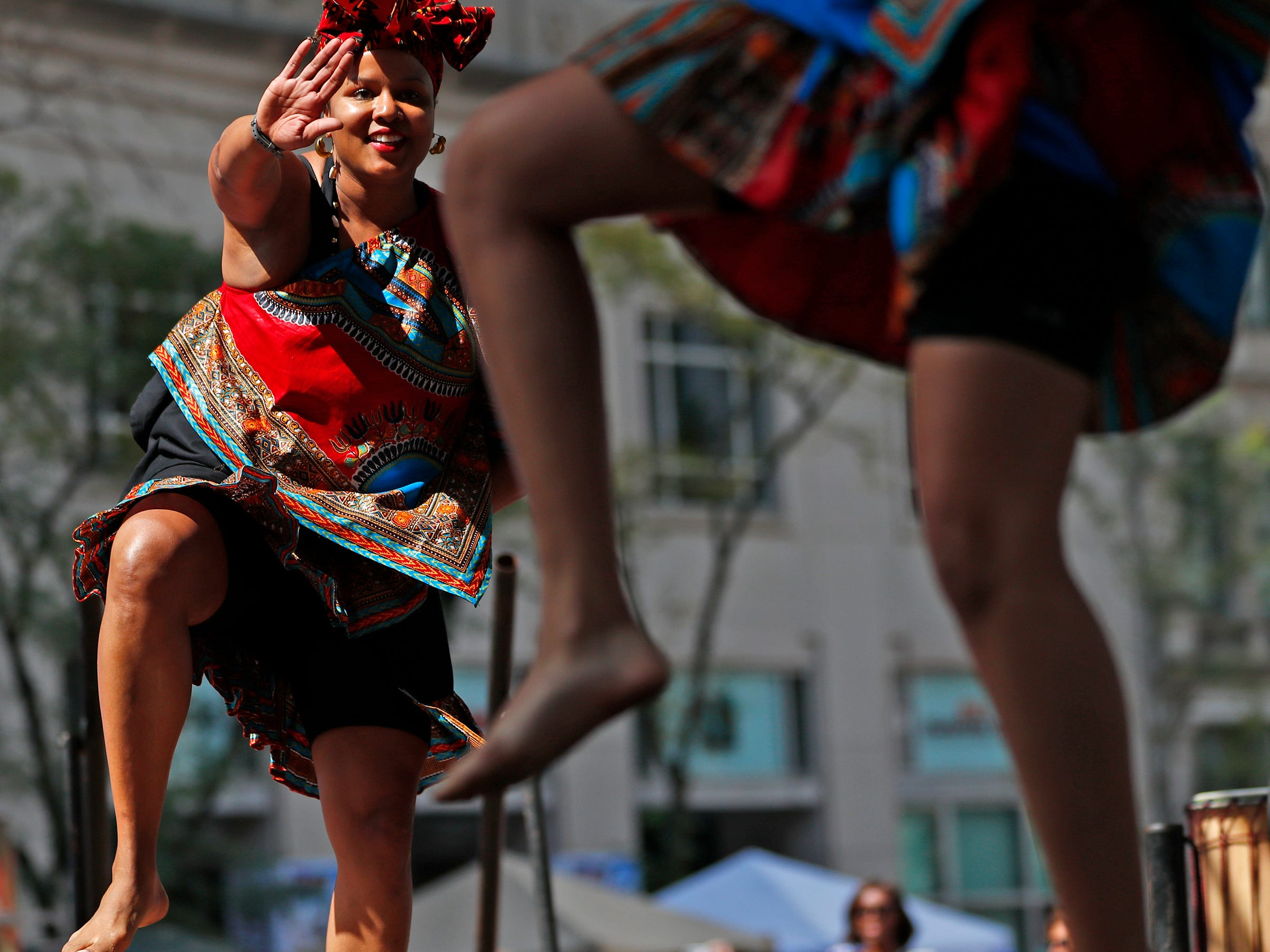 Singers, musicians and dancers from a variety of cultures, including these Ronne Stone, left, from the Epiphany Dance Collective, performed during the YMCA World Fest, on Monument Circle, Thursday, Sept. 13, 2018. YMCA of Greater Indianapolis hosts the free event that celebrates cultures including international food vendors, music, sports, and performers.
