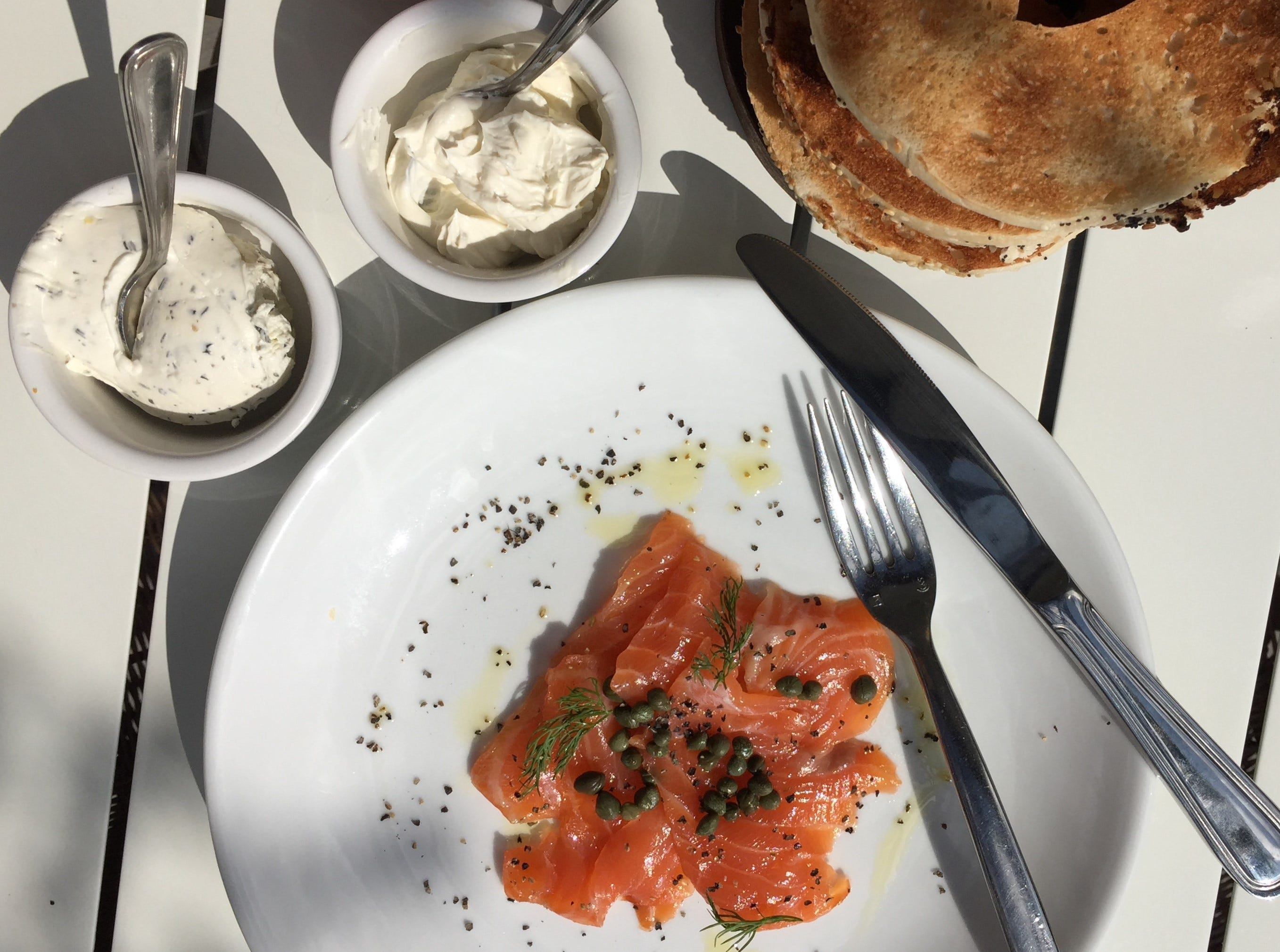 Lox cured by Indianapolis' own Smoking Goose Meatery comes with herbed and plain cream cheese and a stack of bagels at Just Pop In! popcorn bar and cafe at 6406 Cornell Ave. in the Broad Ripple  community of Indianapolis.