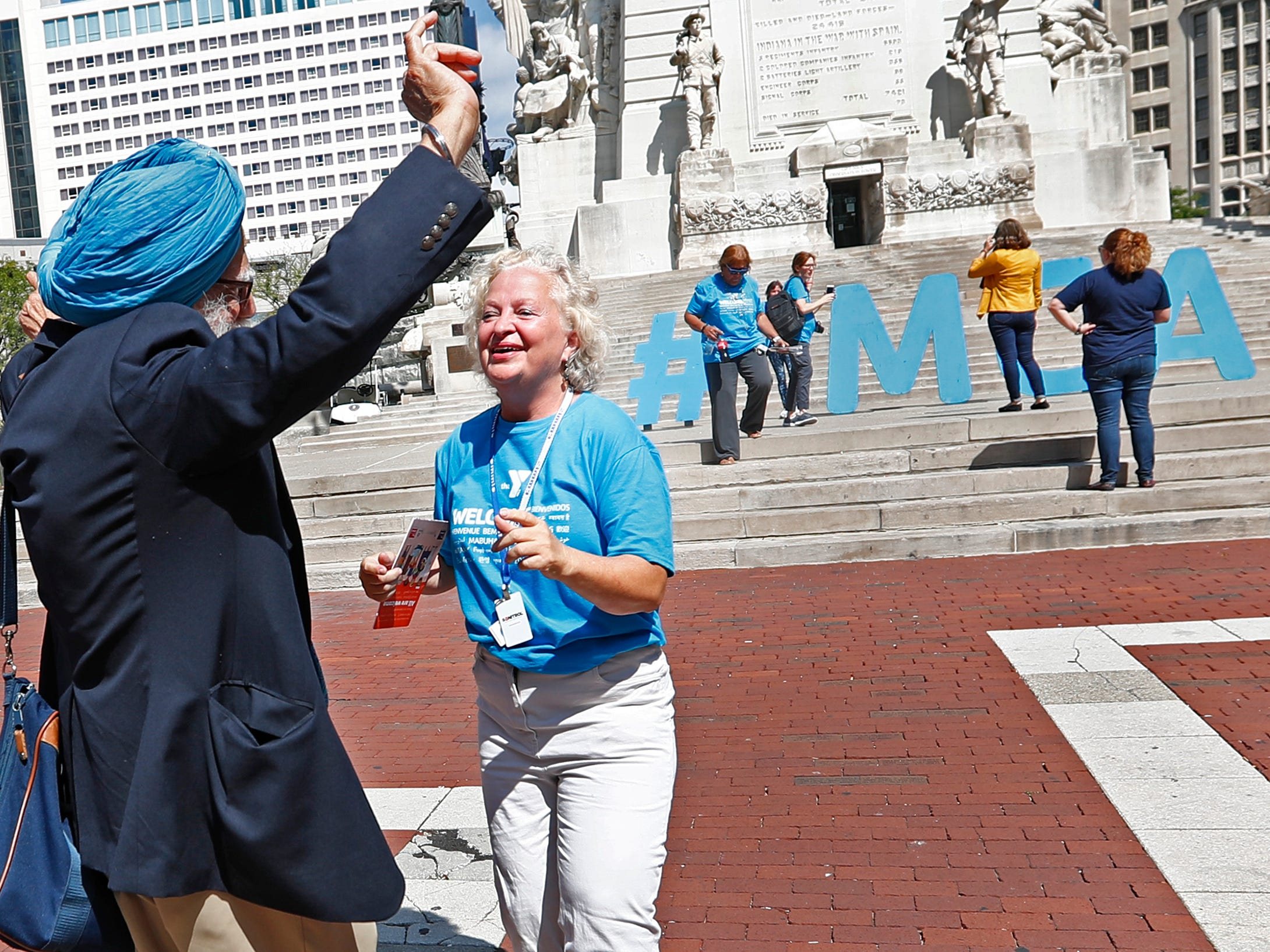 K.P. Singh, left, and Jane Gelhausen dance to music during the YMCA World Fest, on Monument Circle, Thursday, Sept. 13, 2018. YMCA of Greater Indianapolis hosts the free event that celebrates cultures including international food vendors, music, sports, and performers.