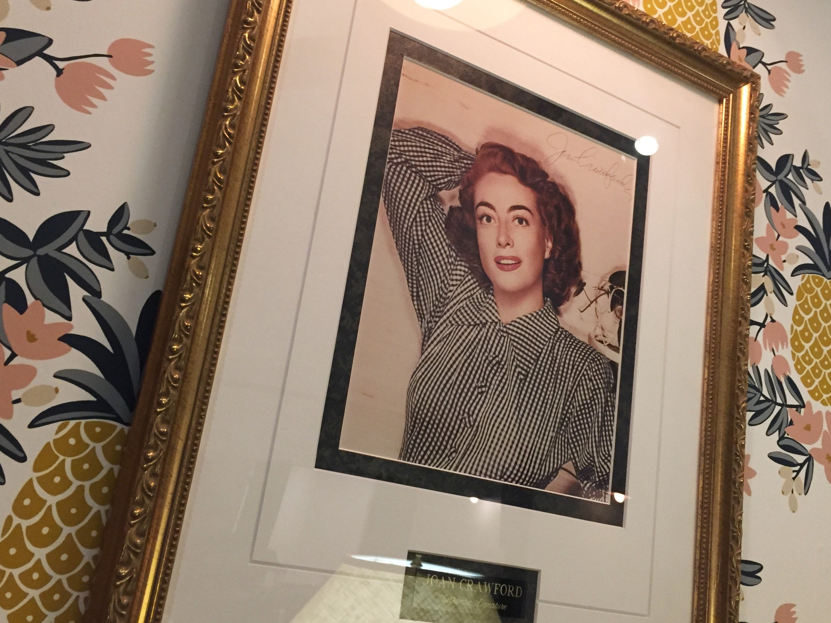 Family heirlooms like this signed portrait of actress Joan Crawford pepper the decor at Just Pop In! popcorn bar and cafe at 6406 Cornell Ave. in the Broad Ripple  community of Indianapolis.