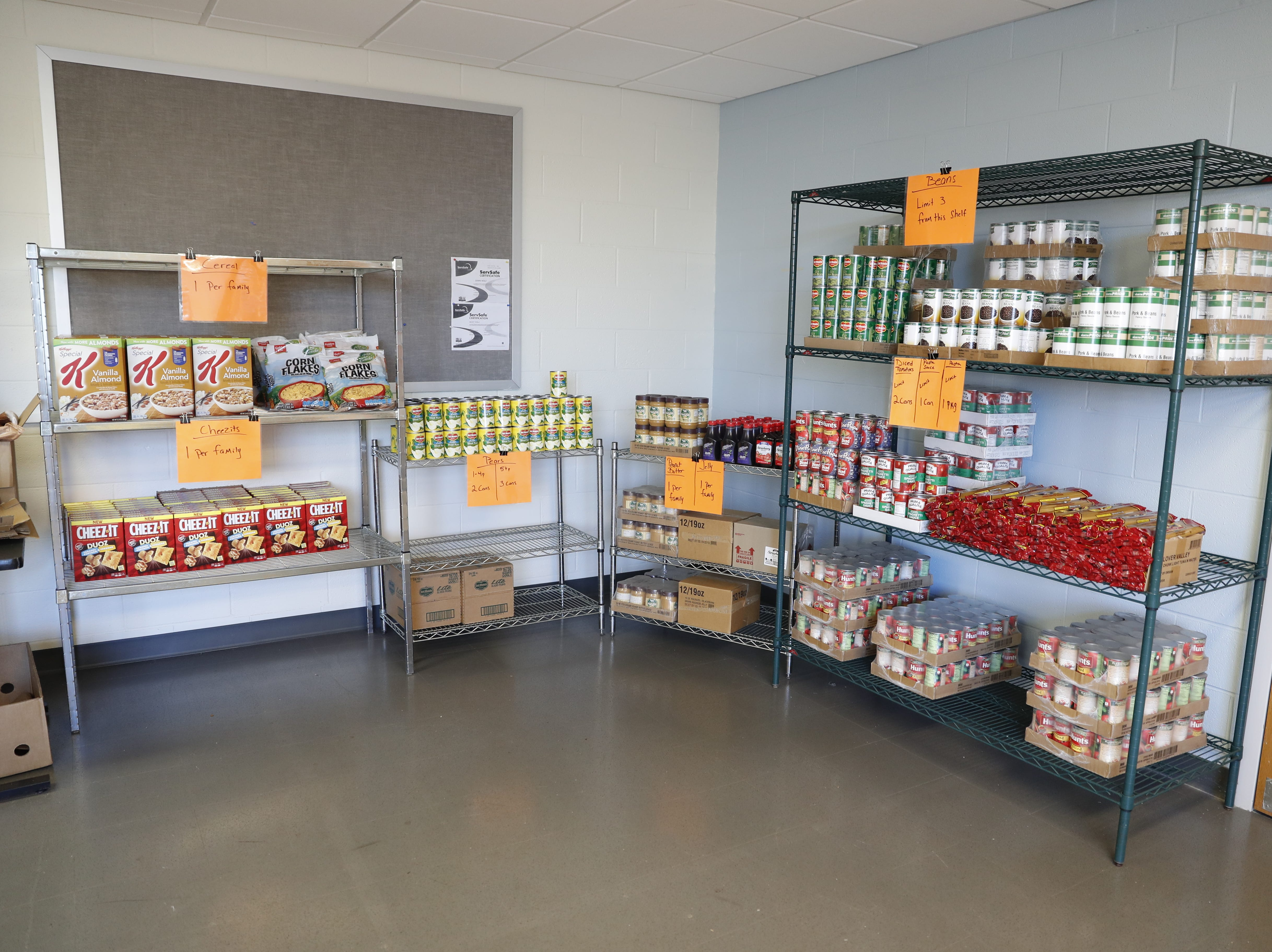 Food stuffs are organize for students during the official opening of Gleaners Hamilton County Cupboard food pantry at Ivy Tech in Noblesville Ind. on Thursday, Sept. 13, 2018. The Joint partnership among Gleaners, Ivy Tech and Goodwill will serve college students who are food-insecure.