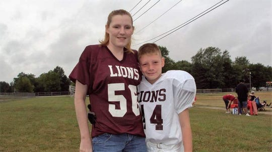 Lucas Willoughby with his mom during his youth football days.