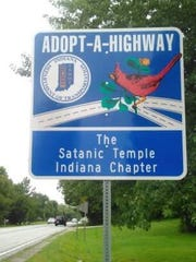 An Adopt-A-Highway sign along  U.S. 421 in Boone County lists its sponsor: The Satanic Temple Indiana Chapter.