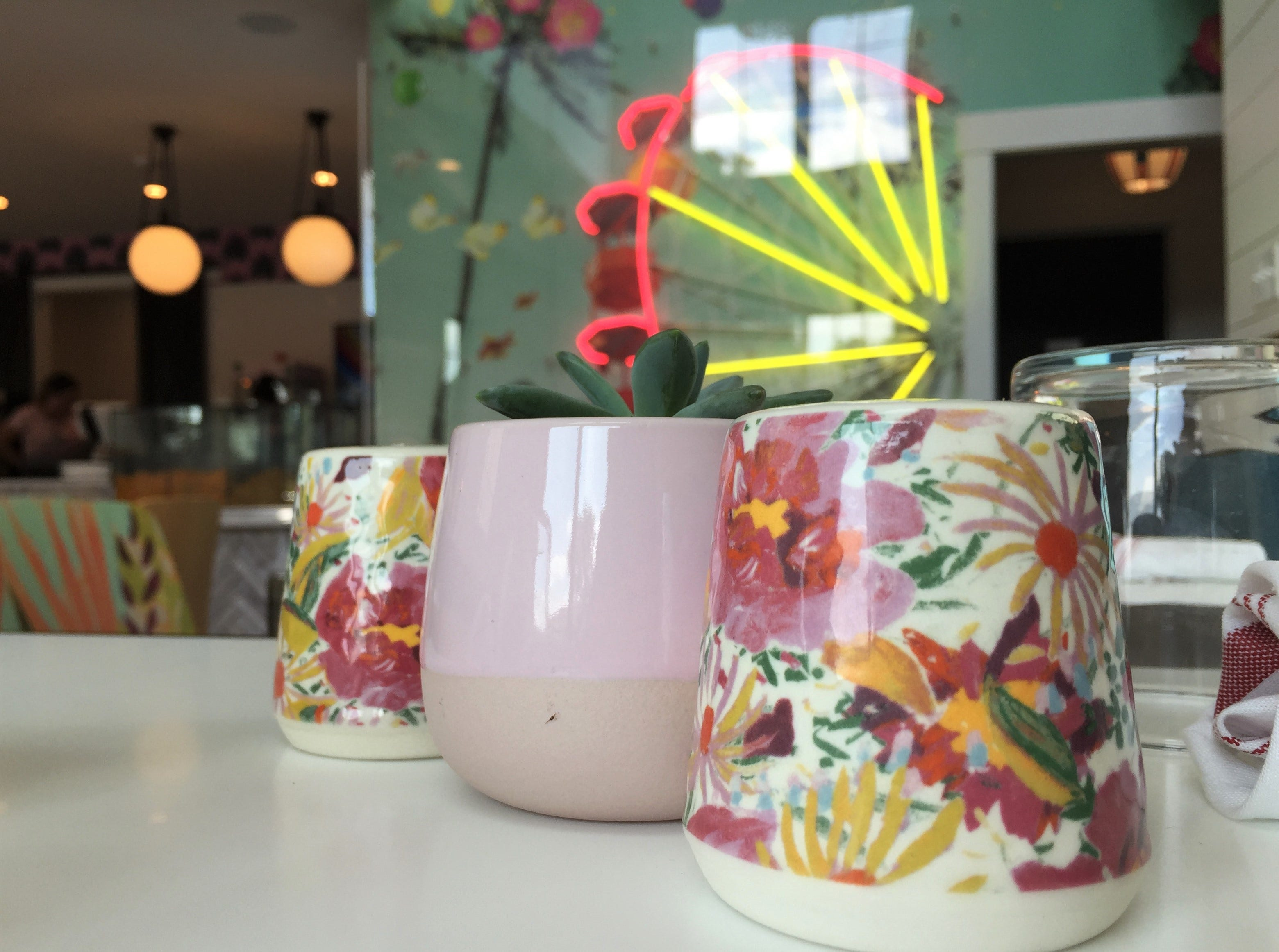 Salt and pepper shakers match floral-print chairs at Just Pop In! popcorn bar and cafe at 6406 Cornell Ave. in the Broad Ripple  community of Indianapolis.