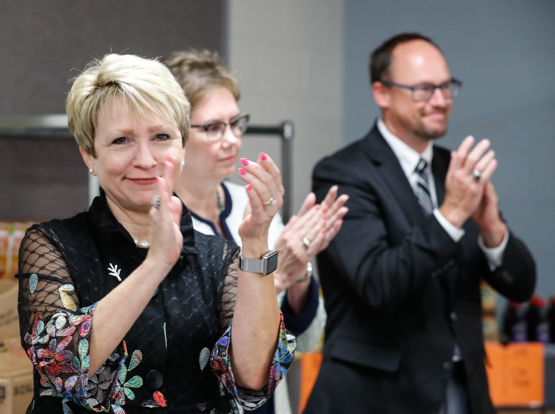 From left, Dr. Sue Ellspermann, president of Ivy Tech, Dr. Kathleen Lee, chancellor of Ivy Tech, Kent Kramer, president of Goodwill, and John Elliott, president/CEO of Gleaners Food Bank, attend the official opening of Gleaners Hamilton County Cupboard food pantry at Ivy Tech in Noblesville Ind. on Thursday, Sept. 13, 2018. The Joint partnership among Gleaners, Ivy Tech and Goodwill will serve college students who are food-insecure.