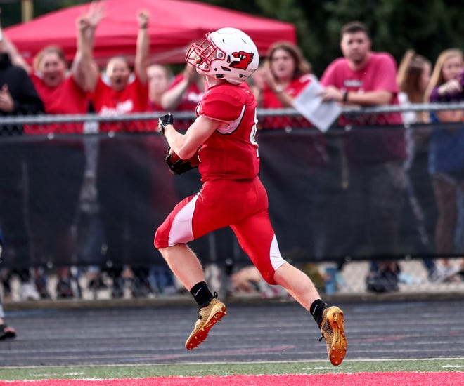 Southport wide receiver Lucas Willoughby (4) takes a pass more than 90-yards for a touchdown against Roncalli on, Aug. 17, 2018. The catch and pass set a school record for longest play.