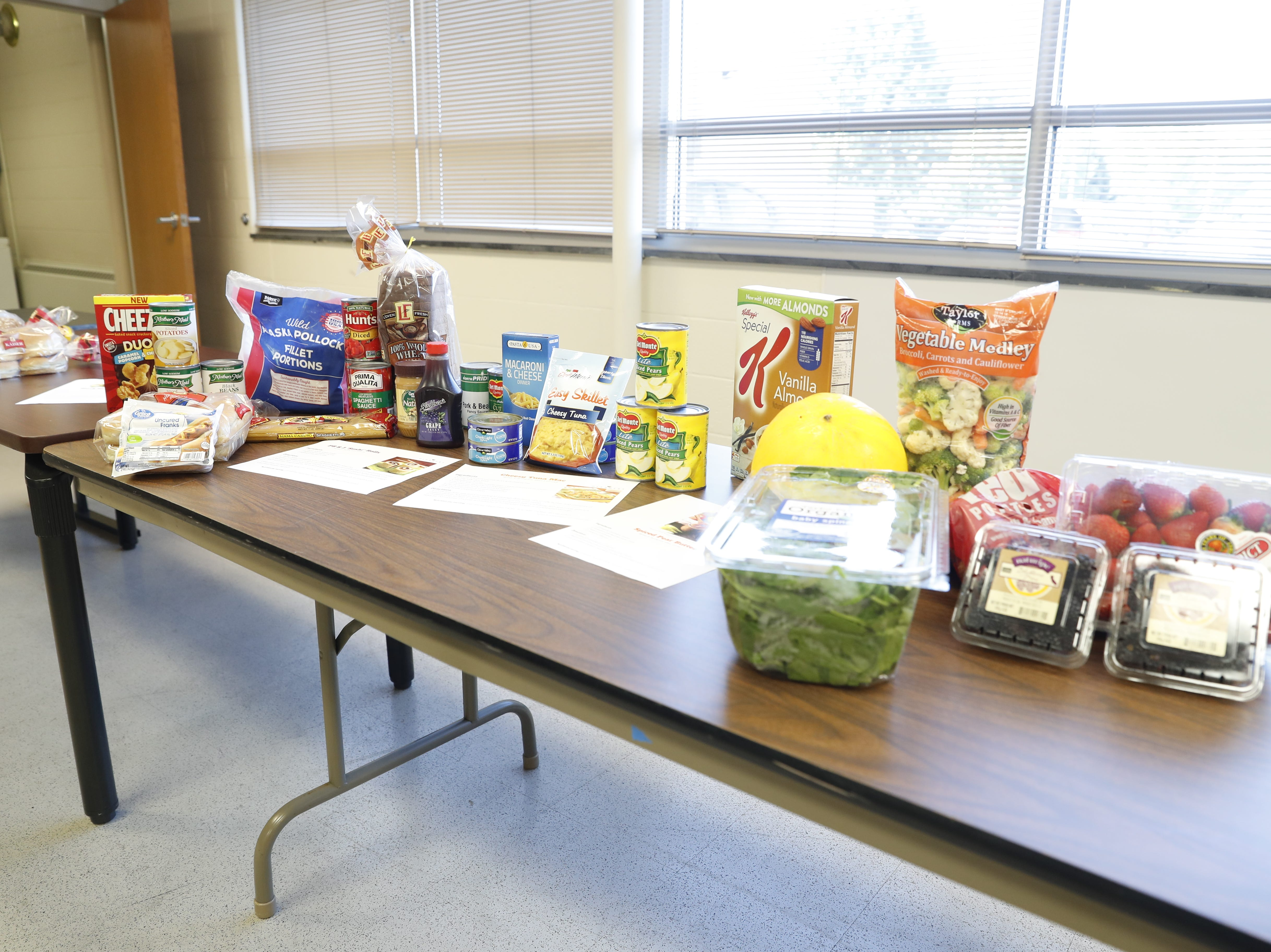 Food that could feed a family of three for eight to twelve meals is set out during the official opening of Gleaners Hamilton County Cupboard food pantry at Ivy Tech in Noblesville Ind. on Thursday, Sept. 13, 2018. The Joint partnership among Gleaners, Ivy Tech and Goodwill will serve college students who are food-insecure.