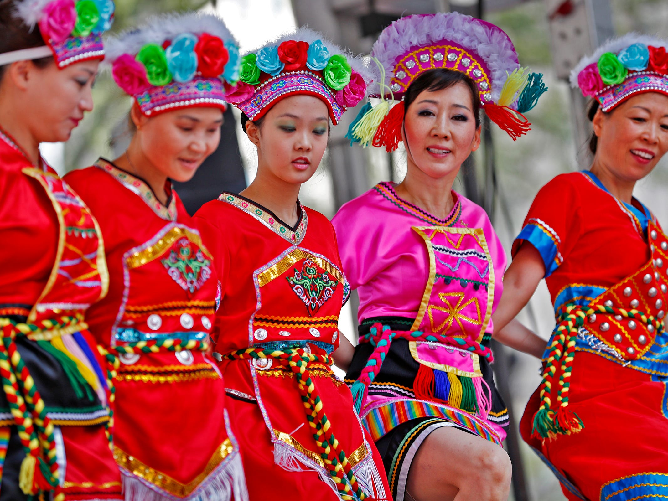 Singers, musicians and dancers from a variety of cultures, including these dancers from the Indianapolis Chinese Performing Arts, Inc., performed during the YMCA World Fest, on Monument Circle, Thursday, Sept. 13, 2018. YMCA of Greater Indianapolis hosts the free event that celebrates cultures including international food vendors, music, sports, and performers.