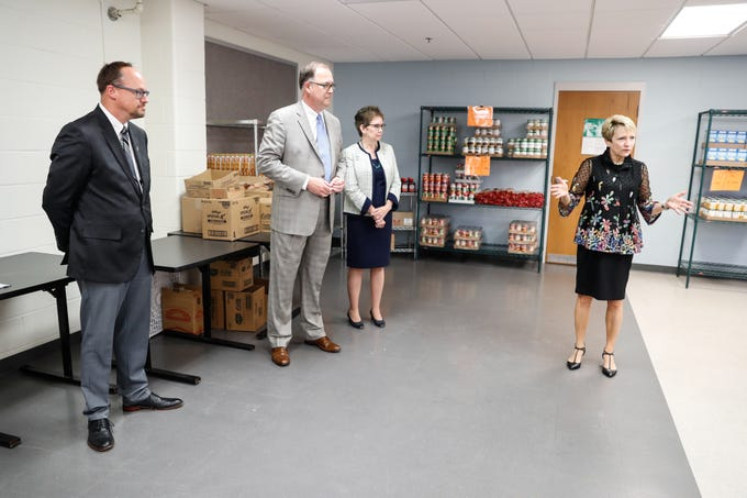 Dr. Sue Ellspermann, president of Ivy Tech, right,  gives remarks during the official opening of Gleaners Hamilton County Cupboard food pantry at Ivy Tech in Noblesville Ind. on Thursday, Sept. 13, 2018. The Joint partnership among Gleaners, Ivy Tech and Goodwill will serve college students who are food-insecure. From left, Kent Kramer, president of Goodwill, John Elliott, president and CEO of Gleaners Food Bank, Dr. Kathleen Lee, chancellor of Ivy Tech.