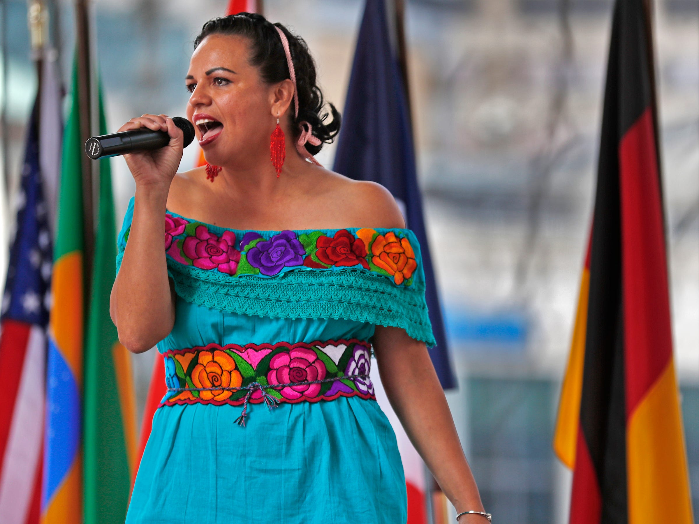 Singers, musicians and dancers from a variety of cultures performed during the YMCA World Fest, on Monument Circle, Thursday, Sept. 13, 2018. YMCA of Greater Indianapolis hosts the free event that celebrates cultures including international food vendors, music, sports, and performers.