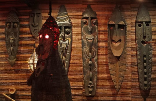 Collections of Papua New Guinea native art at Inferno Room. The tiki lounge opened Sept. 11, 2018, in the Fountain Square, area of Indianapolis.