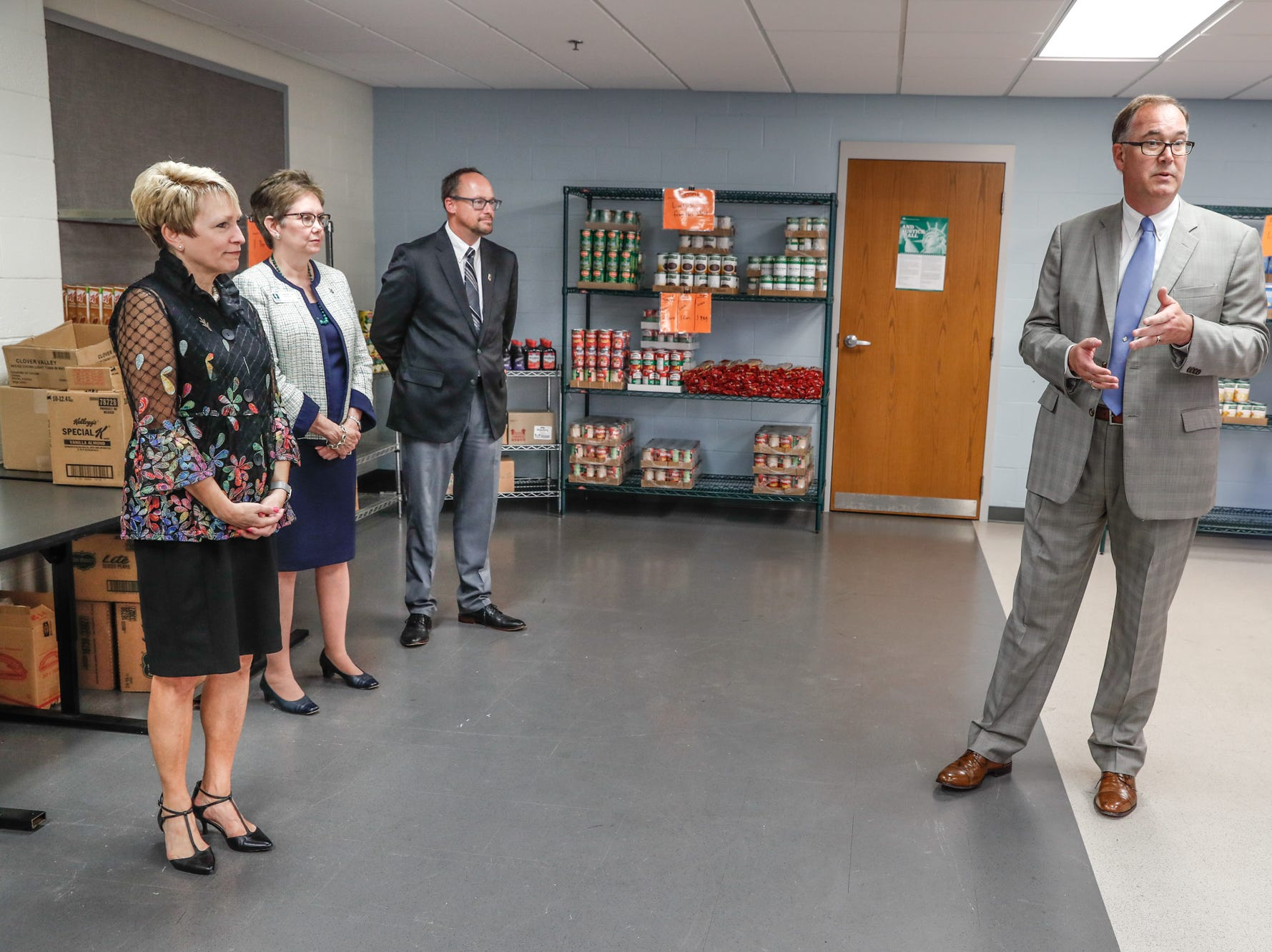 Left to right, Dr. Sue Ellspermann, president of Ivy Tech, Dr. Kathleen Lee, chancellor of Ivy Tech, Kent Kramer, president of Goodwill, and John Elliott, president and CEO of Gleaners Food Bank, take turns giving remarks during the official opening of Gleaners Hamilton County Cupboard food pantry at Ivy Tech in Noblesville Ind. on Thursday, Sept. 13, 2018. The Joint partnership among Gleaners, Ivy Tech and Goodwill will serve college students who are food-insecure.