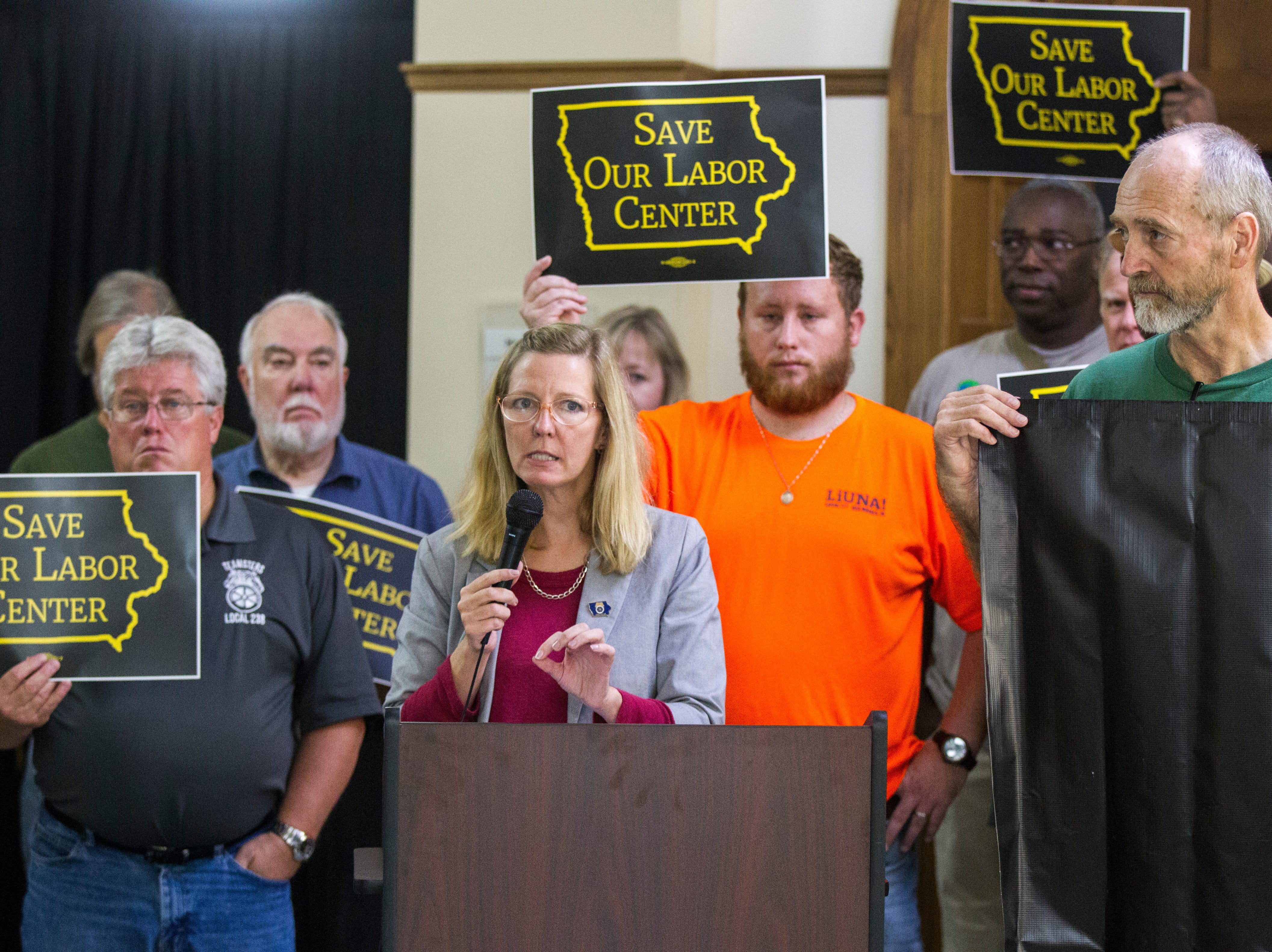 """Tracy Leone, of Teamsters Local 238 and the """"Save Our Labor Center"""" coalition, speaks to supporters after an Iowa Board of Regents meeting on Thursday, Sept. 13, 2018, outside the Iowa Memorial Union on the University of Iowa campus in Iowa City."""
