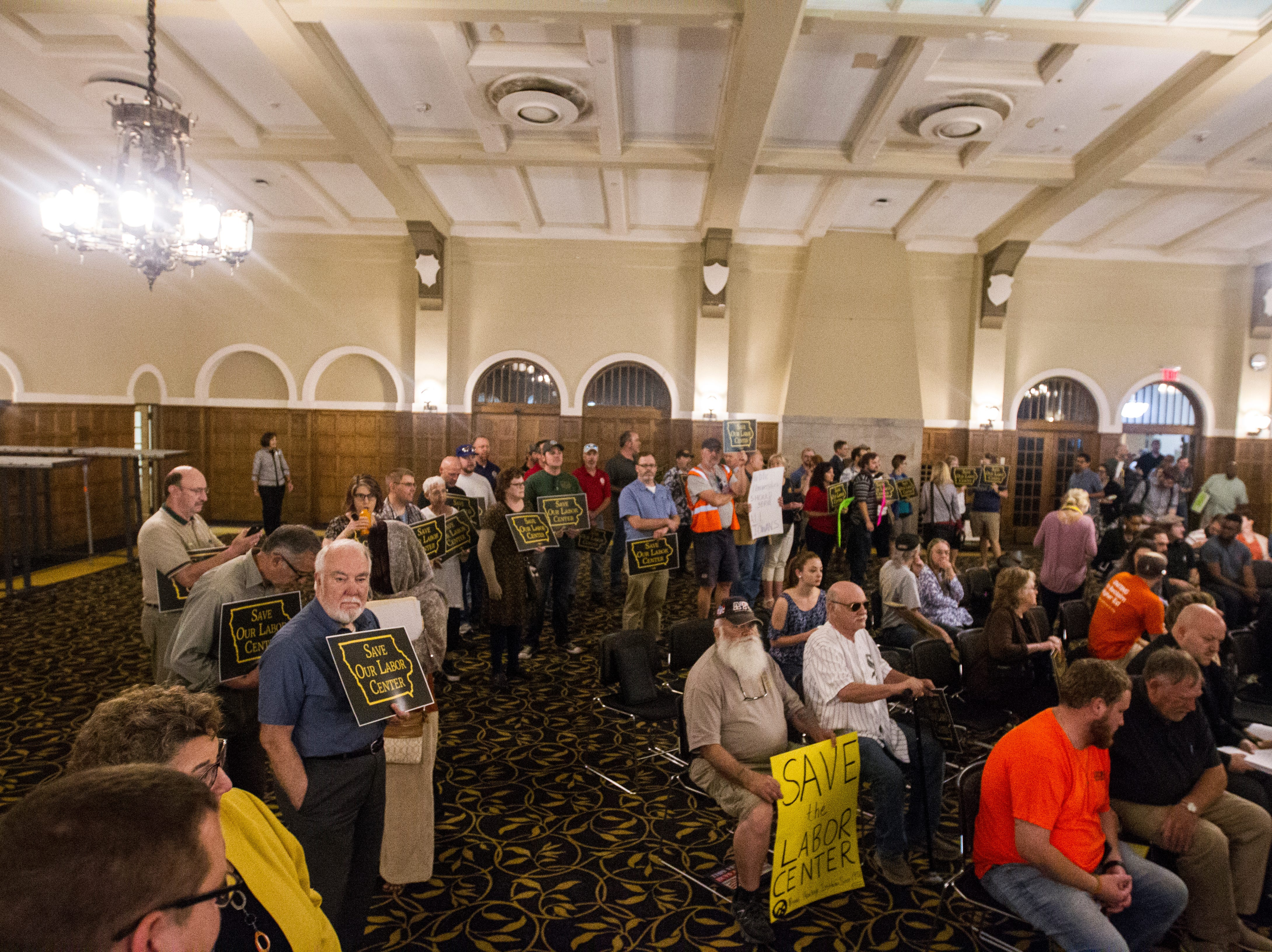 """""""Save Our Labor Center"""" coalition supporters gather during an Iowa Board of Regents meeting on Thursday, Sept. 13, 2018, in the Iowa Memorial Union main ballroom on the University of Iowa campus in Iowa City."""