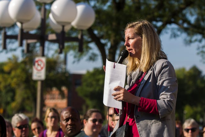 """Tracy Leone, of Teamsters Local 238 and the """"Save Our Labor Center"""" coalition, speaks to supporters before an Iowa Board of Regents meeting on Thursday, Sept. 13, 2018, outside the Iowa Memorial Union on the University of Iowa campus in Iowa City."""
