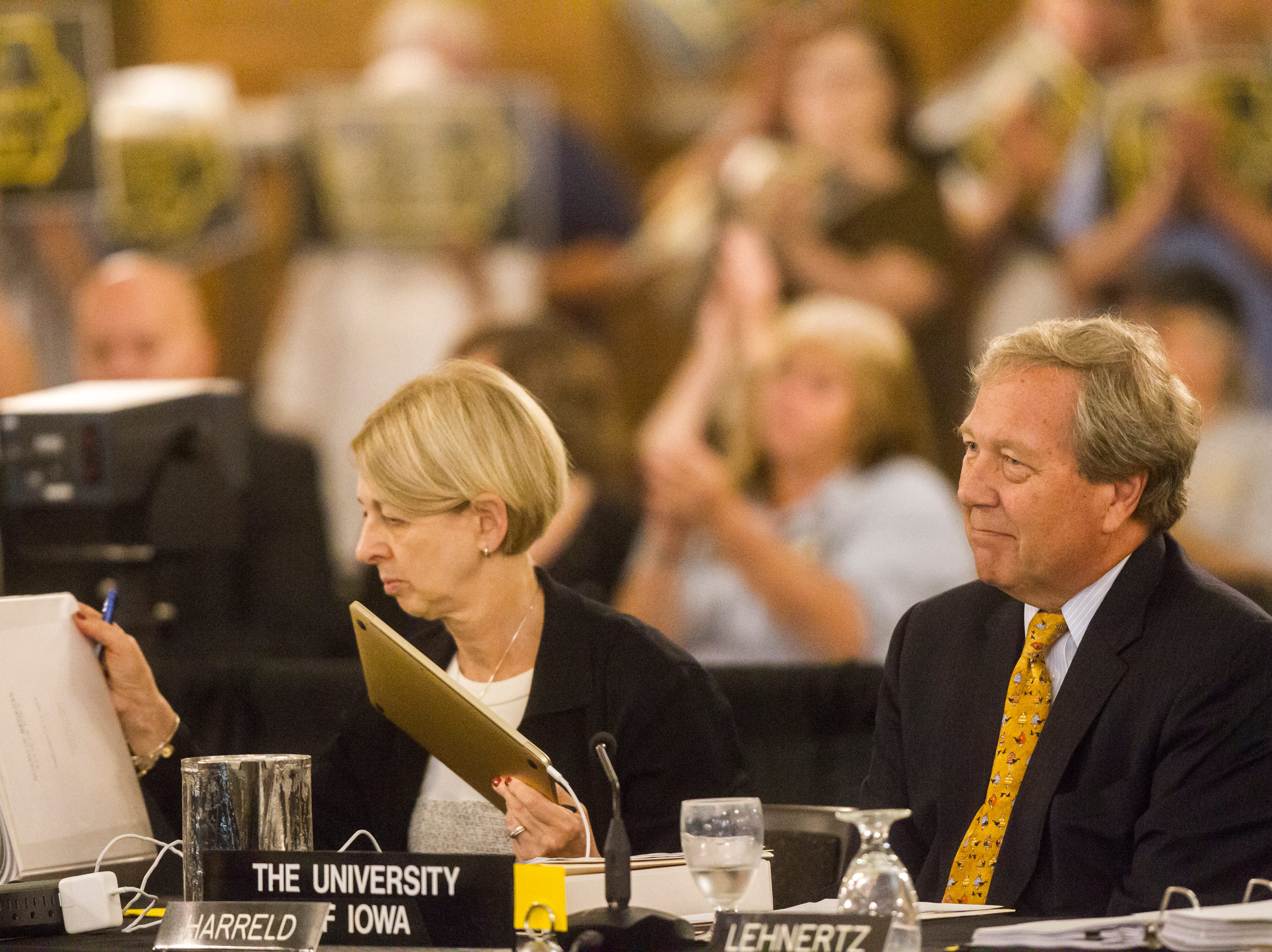 University of Iowa President J. Bruce Harreld (right) listens to public comment during an Iowa Board of Regents meeting on Thursday, Sept. 13, 2018, in the Iowa Memorial Union main ballroom on the University of Iowa campus in Iowa City.