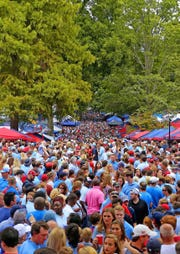 """Fans gather in The Grove to await the football team's """"Rebel Walk"""" to the stadium before a game in 2017. The Grove, approximately 10 acres located in the middle of the Ole Miss campus in Oxford, is recognized as one of the nation's top tailgating sites."""