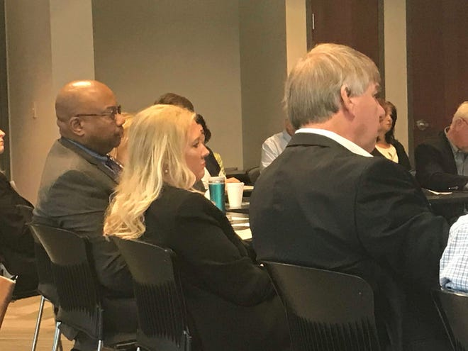 West Tennessee Healthcare CEO Dr. James Ross, Dr. Lisa Piercey and State Representative Ed Jackson listen to an answer to a question during the Healthier Tennessee discussion at The Jackson Chamber on Tuesday.