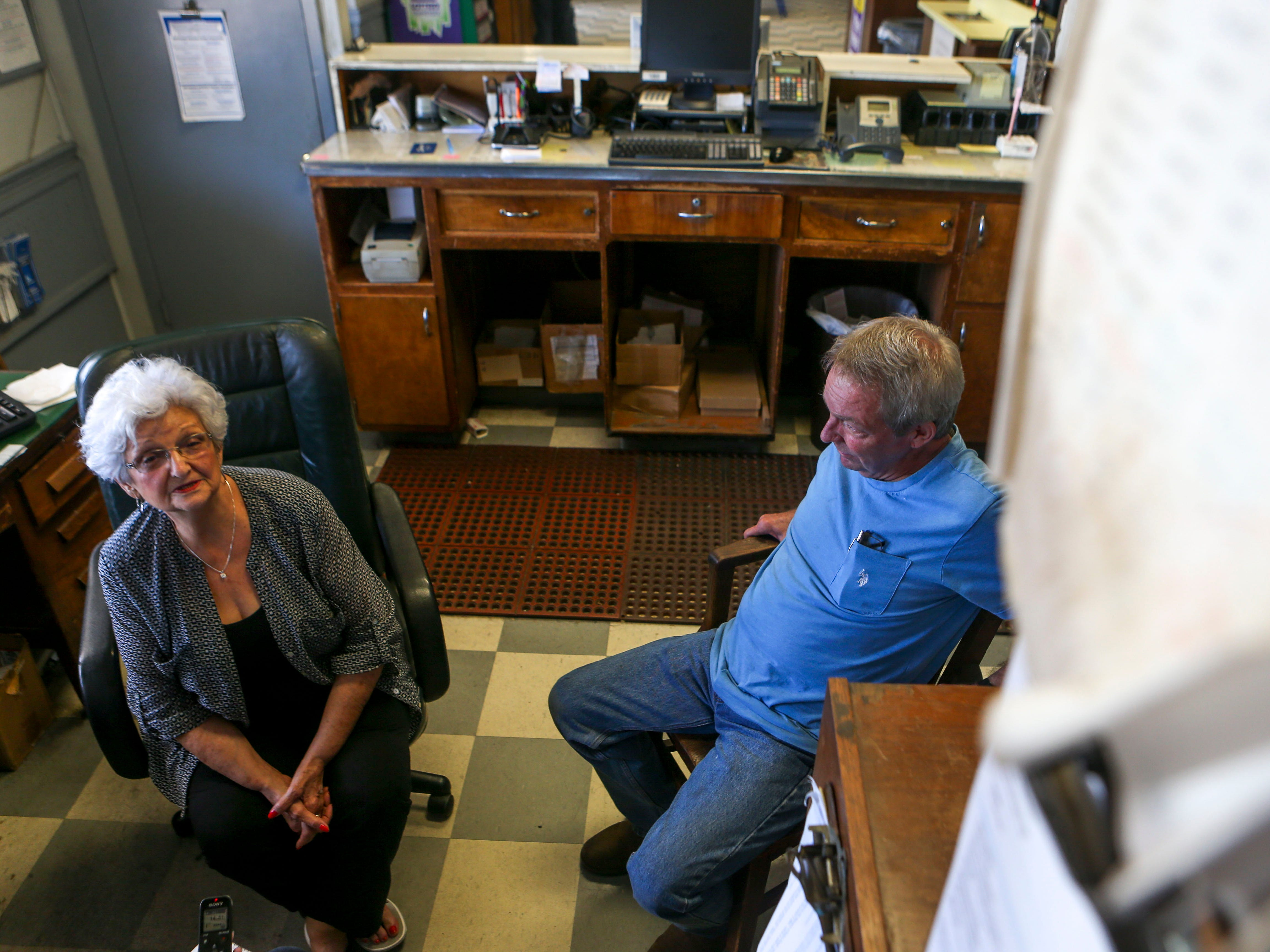 Doris Hollowell, left, and her son, Mark Hollowell, right, sit in the main office that Doris has operated since 1973 at the Greyhound Bus Station in Jackson, Tenn., on Wednesday, Sept. 12, 2018.