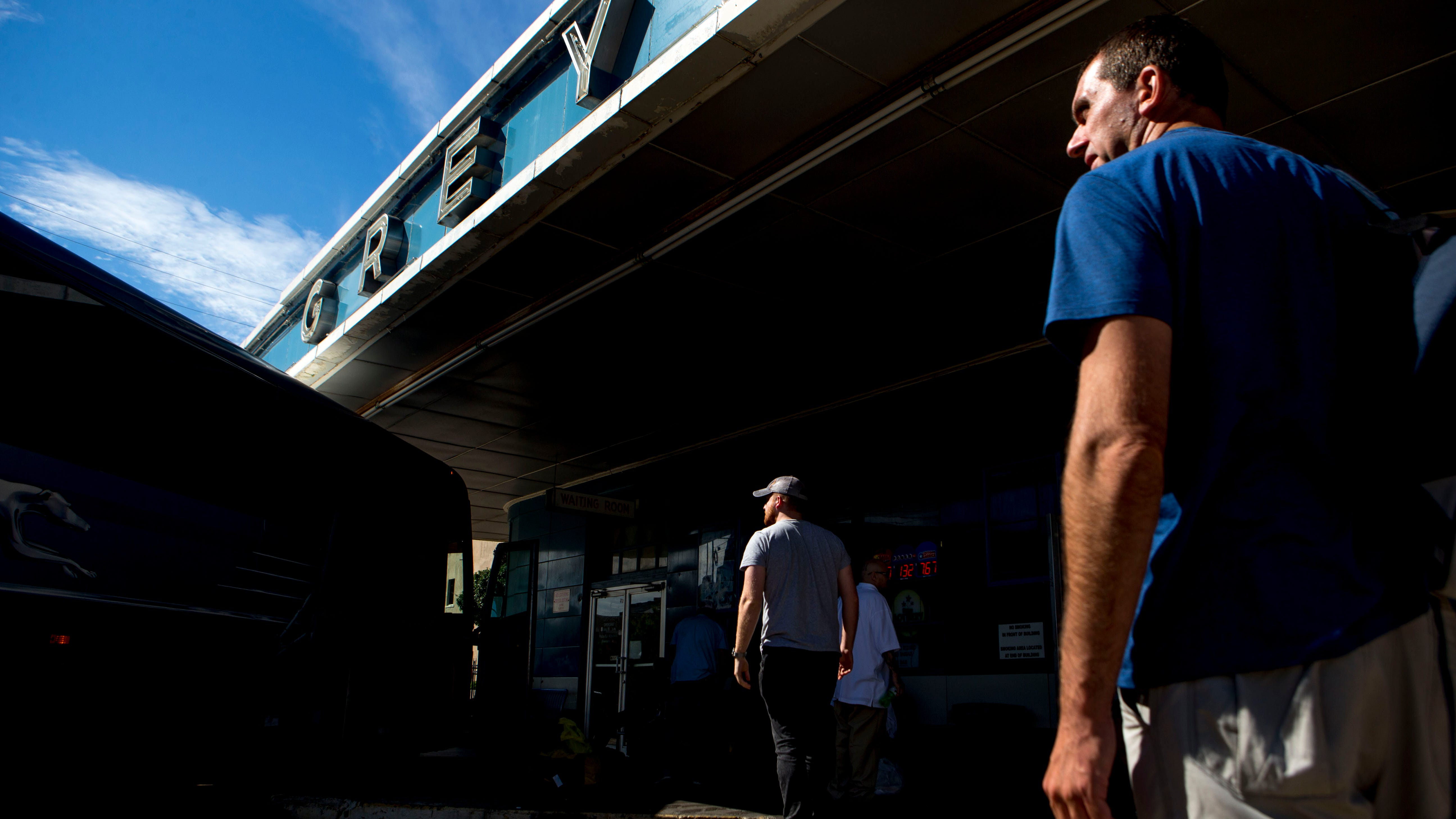 Riders mingle in between their bus and the terminal during a stop at the Greyhound Bus Station in Jackson, Tenn., on Wednesday, Sept. 12, 2018.