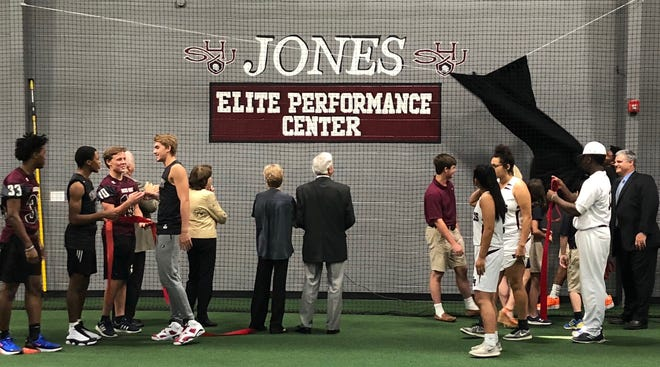 Athletes and visitors look at some of the equipment housed in the Jones Elite Performance Center at Sacred Heart of Jesus High School.