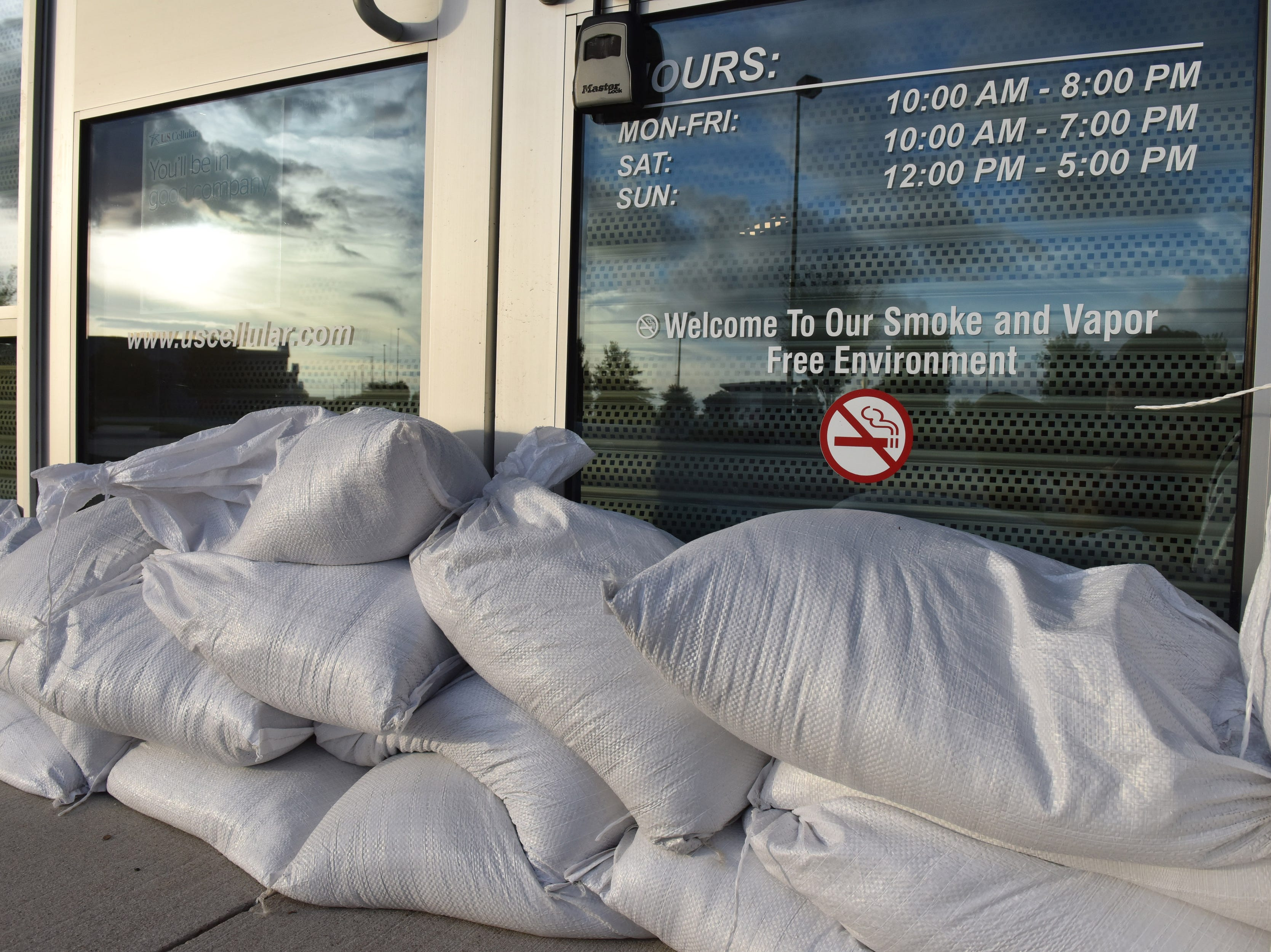 Sep 12, 2018; Elizabeth City, NC, USA; A US Cellular store uses sandbags at their front entrance afternoon as they prepare for the arrival of Hurricane Florence.