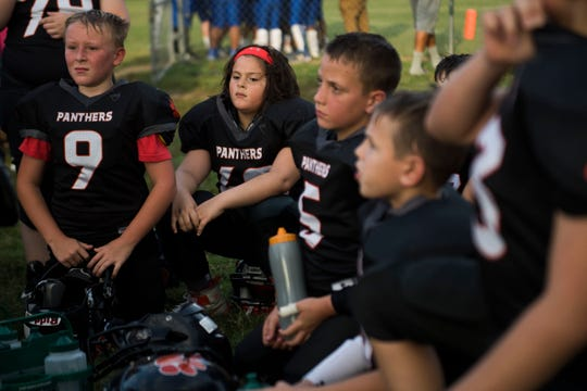 Ava Wooten, 9, of Powell, joins in a huddle with her 9U Powell Youth football team Tuesday, Sept. 11, 2018. Ava is the only girl on her team.