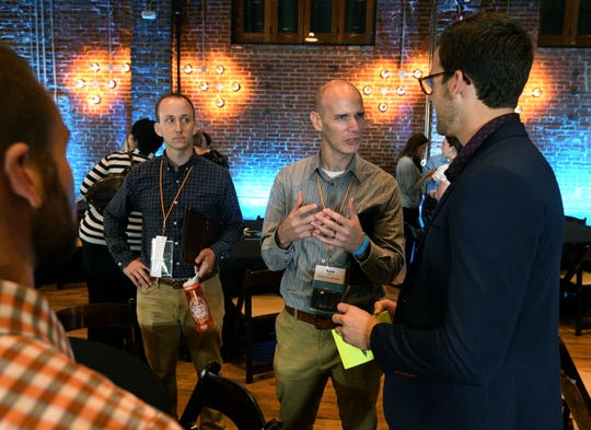 Jeremy Loftis, Adam Brimer, Ryan Matthews and Alex Widmer interact between sessions at the 2018 Endeavor Summit at The Mill and Mine on West Depot Ave. Thursday, September 13, 2018.
