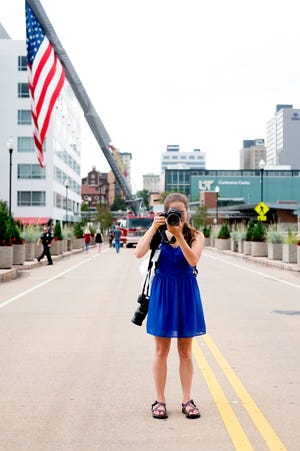 News Sentinel photographer Caitie McMekin takes photos at the Festival on the Fourth in downtown Knoxville  July 4, 2017.