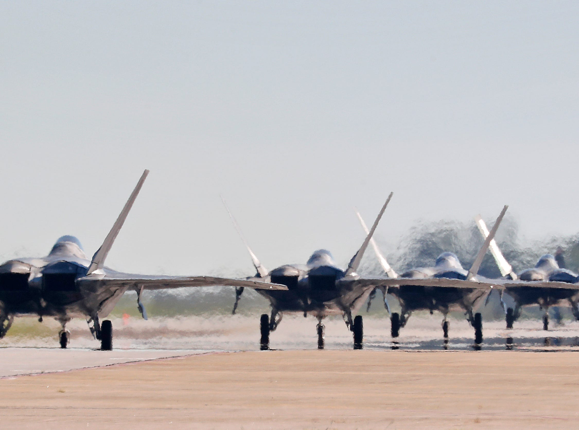 F-22s taxi down the runway as they prepare to depart Langley Air Force Base, Va., Tuesday morning, Sept. 11, 2018, as Hurricane Florence approaches the Eastern Seaboard. Officials from Joint Base Langley-Eustis in Hampton said the base's F-22 Raptors and T-38 Talon training jets, as a precaution, were headed for Rickenbacker Air National Guard Base in central Ohio.