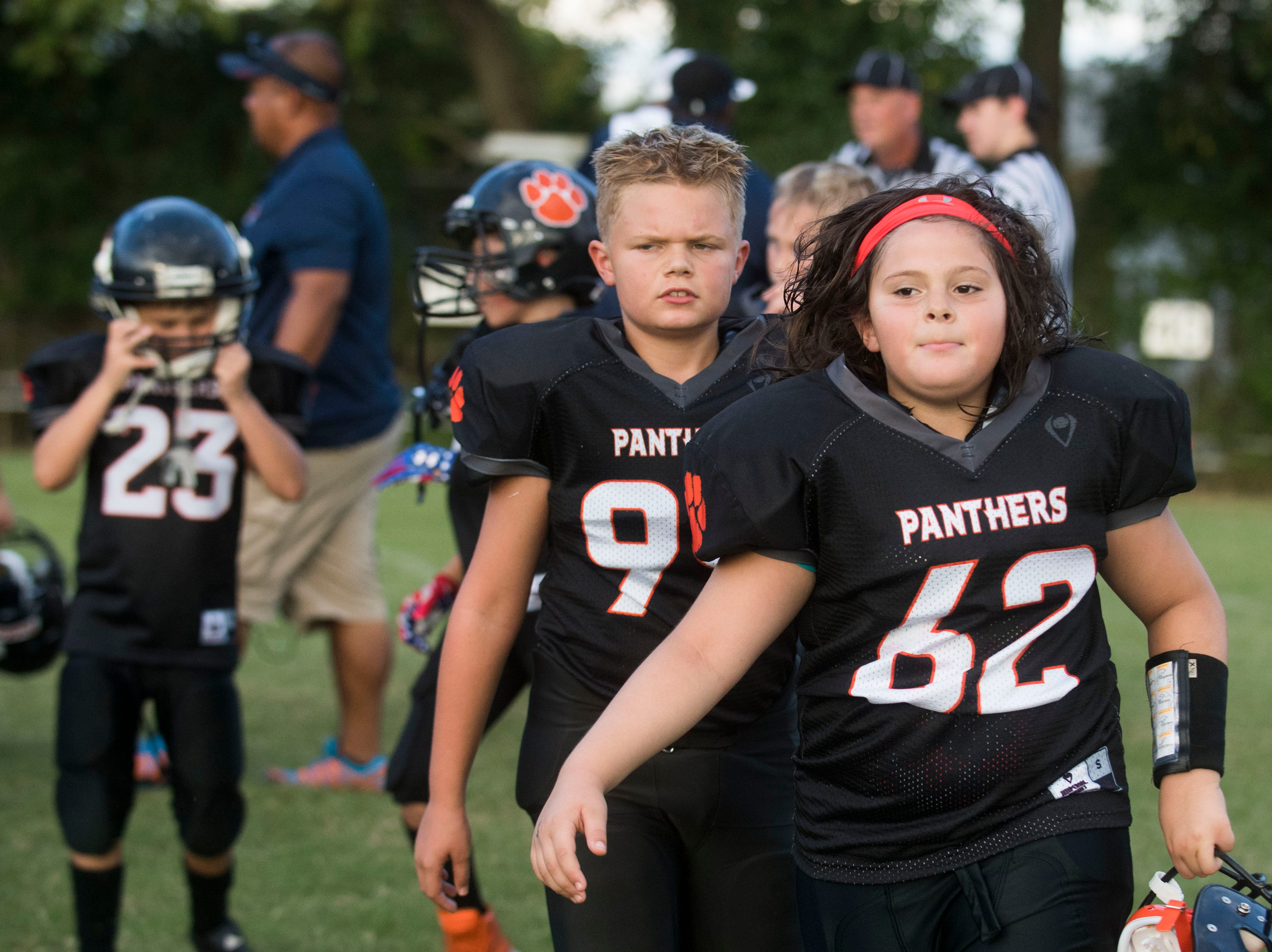 Ava Wooten, 9, of Powell, runs off the field with her 9U Powell Youth football team Tuesday, Sept. 11, 2018.