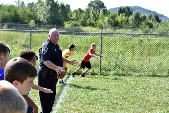 """""""It's purely sports, it's what I enjoy,"""" said Officer Joe """"Opy"""" Henderson. """"My Mom and Dad always said that you give back to the community. Growing up at ballfields, it's the circle of giving back."""""""