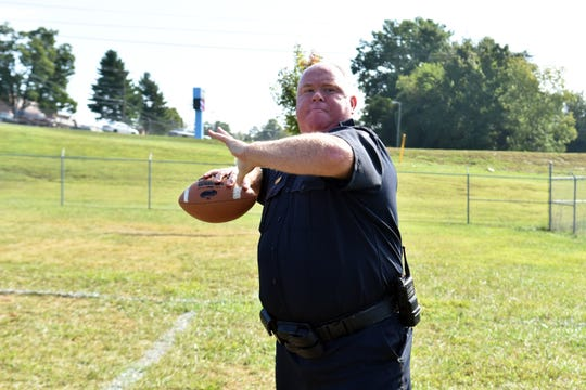 Quarterback/officer Joe Henderson finds his target and prepares to launch the football during a pickup game at recess.