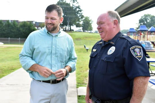 Gibbs Elementary principal Joe Cameron and school officer Joe Henderson survey the playground during recess.