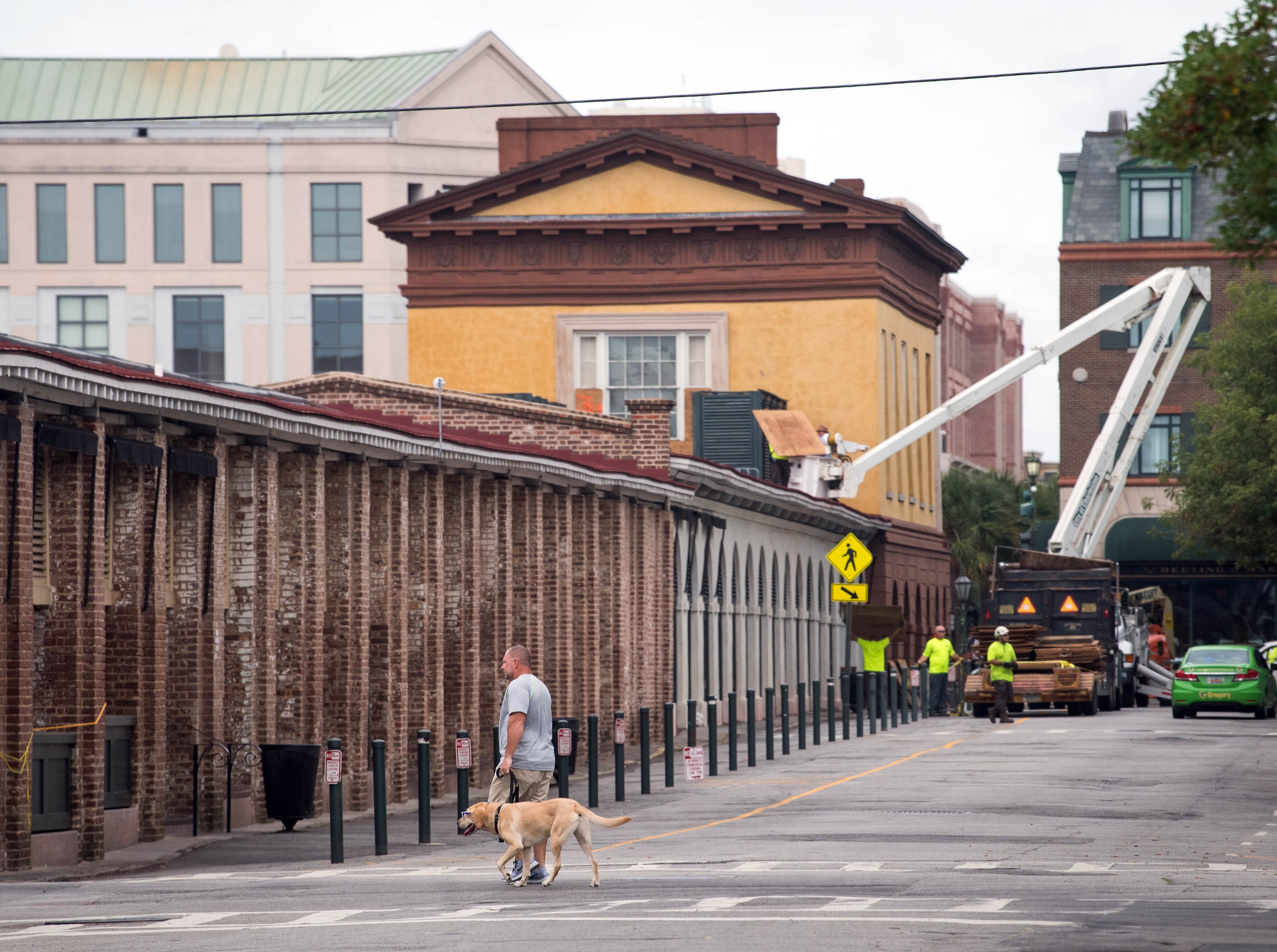 September 13, 2018; Charleston, SC, USA; City of Charleston workers continue to prepare for Hurricane Florence along Market Street before Hurricane Florence makes landfall along the East Coast.